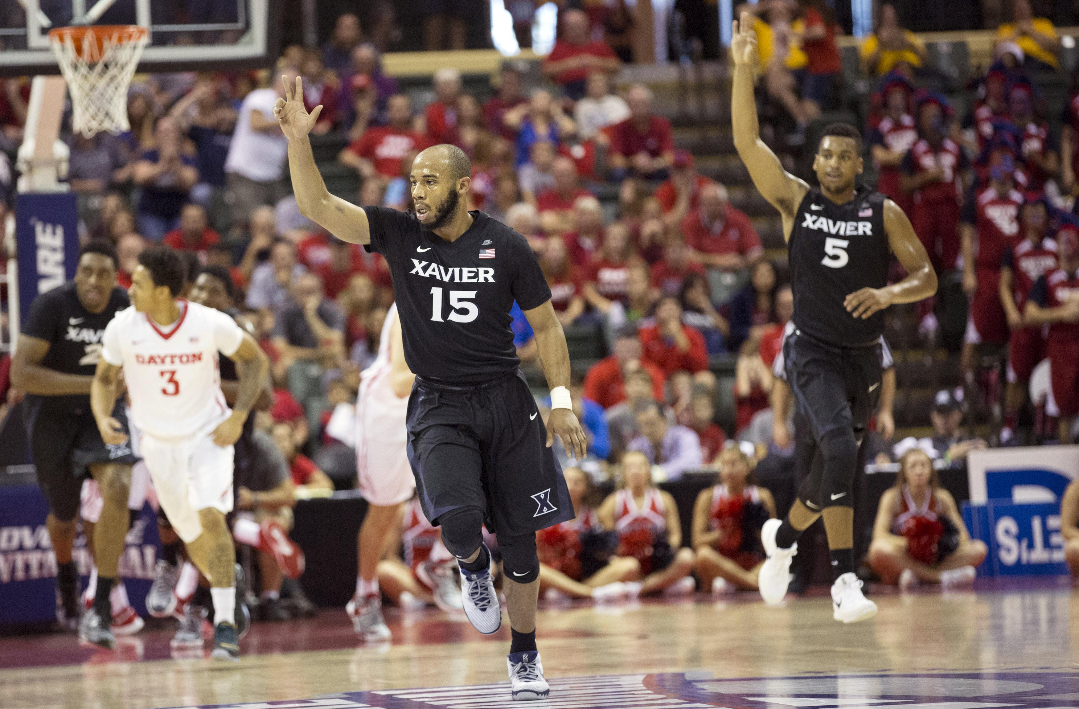 Xavier guard Myles Davis (15) signals his 3-point basket along with guard Trevon Bluiett (5) during the first half of an NCAA college basketball game against Dayton, Sunday, Nov. 29, 2015, in Orlando, Fla. (AP Photo/Willie J. Allen Jr.)