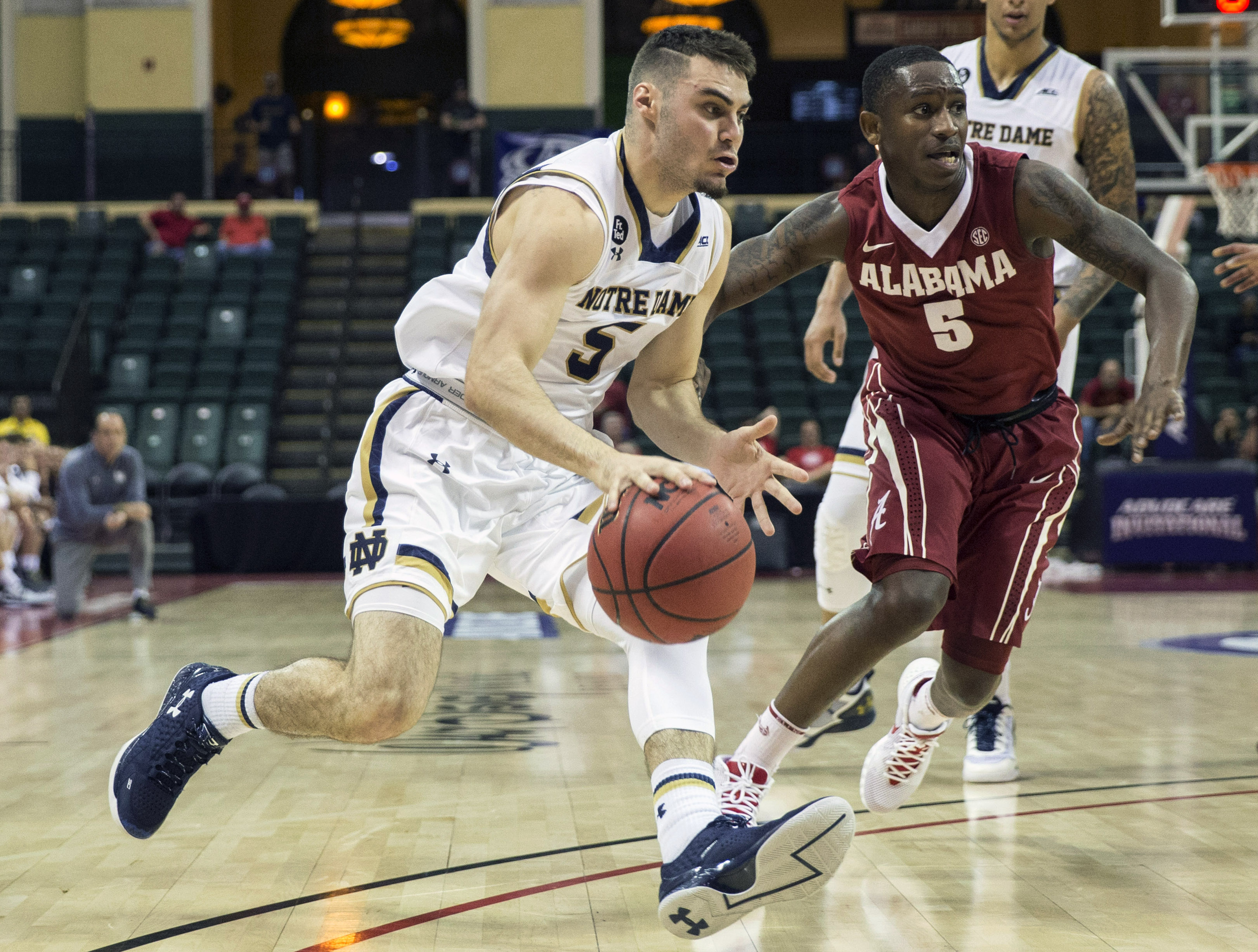 Notre Dame guard Matt Farrell, left, dribbles by Alabama guard Justin Coleman during the first half of an NCAA college basketball game Sunday, Nov. 29, 2015, in Orlando, Fla. (AP Photo/Willie J. Allen Jr.)