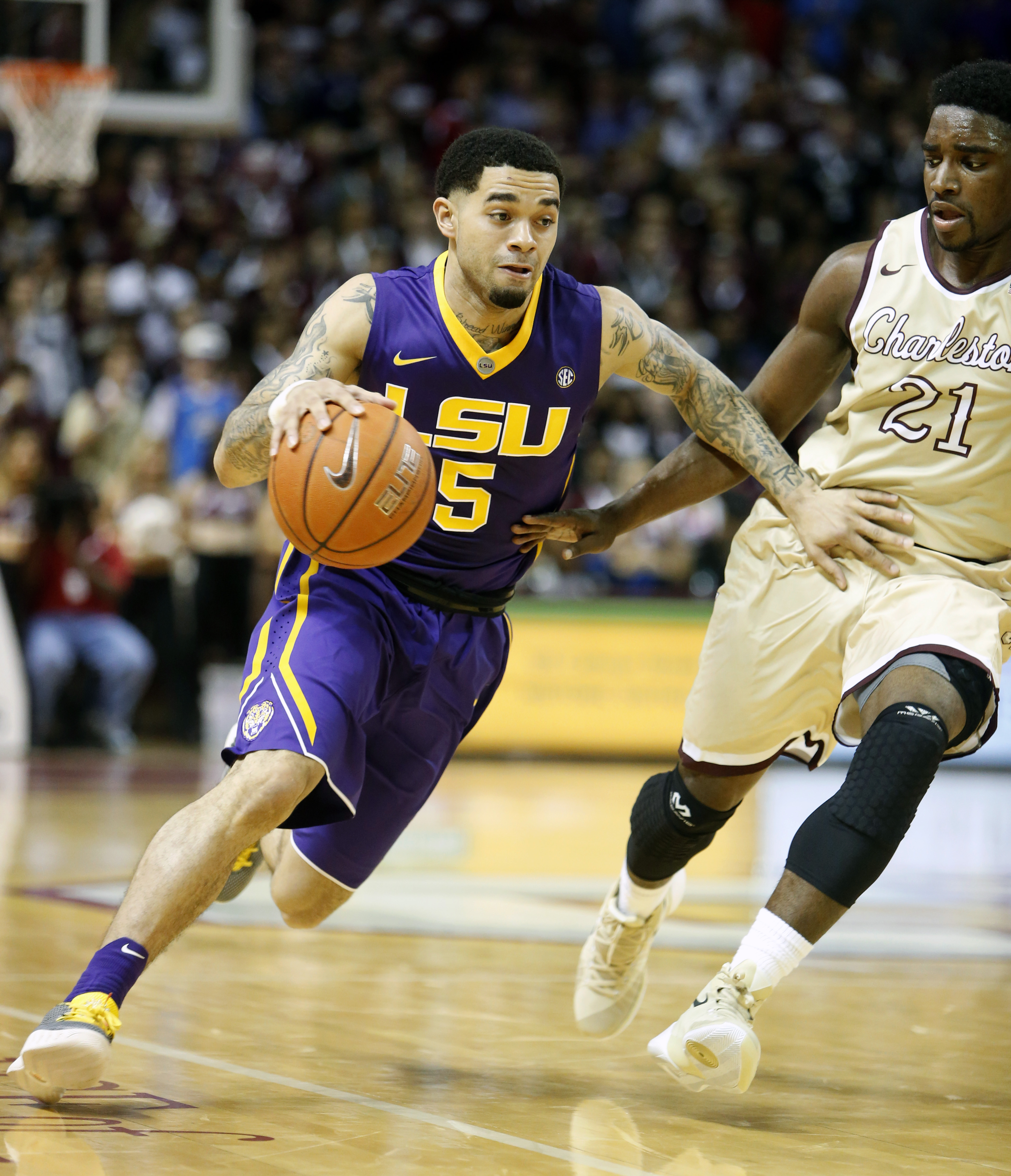 LSU's Josh Gray, at left, drives around College of Charleston's Marquise Pointer during first half action of an NCAA college basketball game Monday Nov. 30, 2015, in Charleston, S.C.  (AP Photo/Mic Smith)