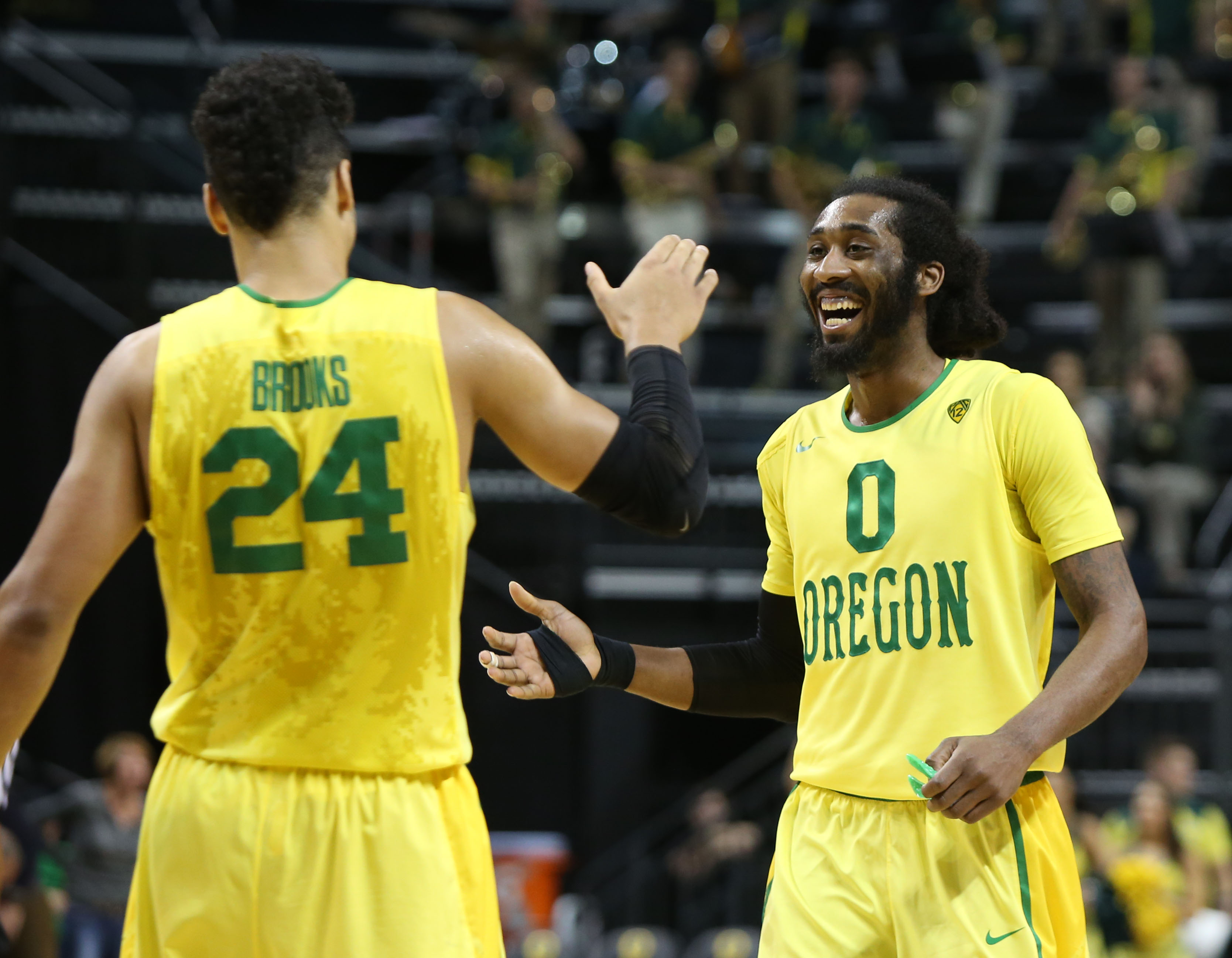 Oregon's Dillon Brooks, left, and Dwayne Benjamin, right, celebrate their 78-73 victory over Fresno State in an NCAA college basketball game, Monday, Nov. 30, 2015, in Eugene, Ore. (AP Photo/Chris Pietsch)