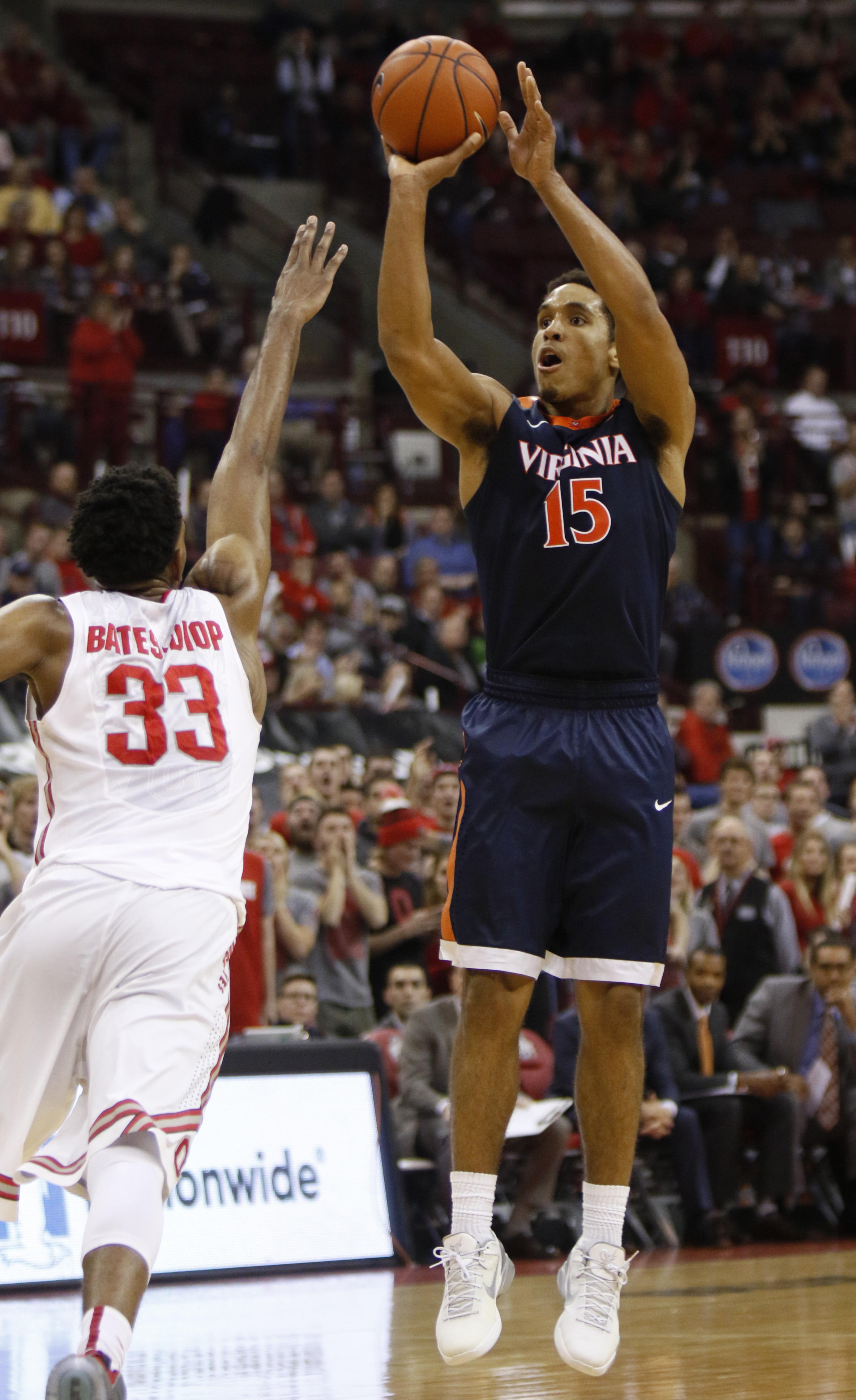 Virginia's Malcolm Brogdon, right, shoots against Ohio State's Keita Bates-Diop during the first half of an NCAA college basketball game in Columbus, Ohio, Tuesday, Dec. 1, 2015. (AP Photo/Paul Vernon)