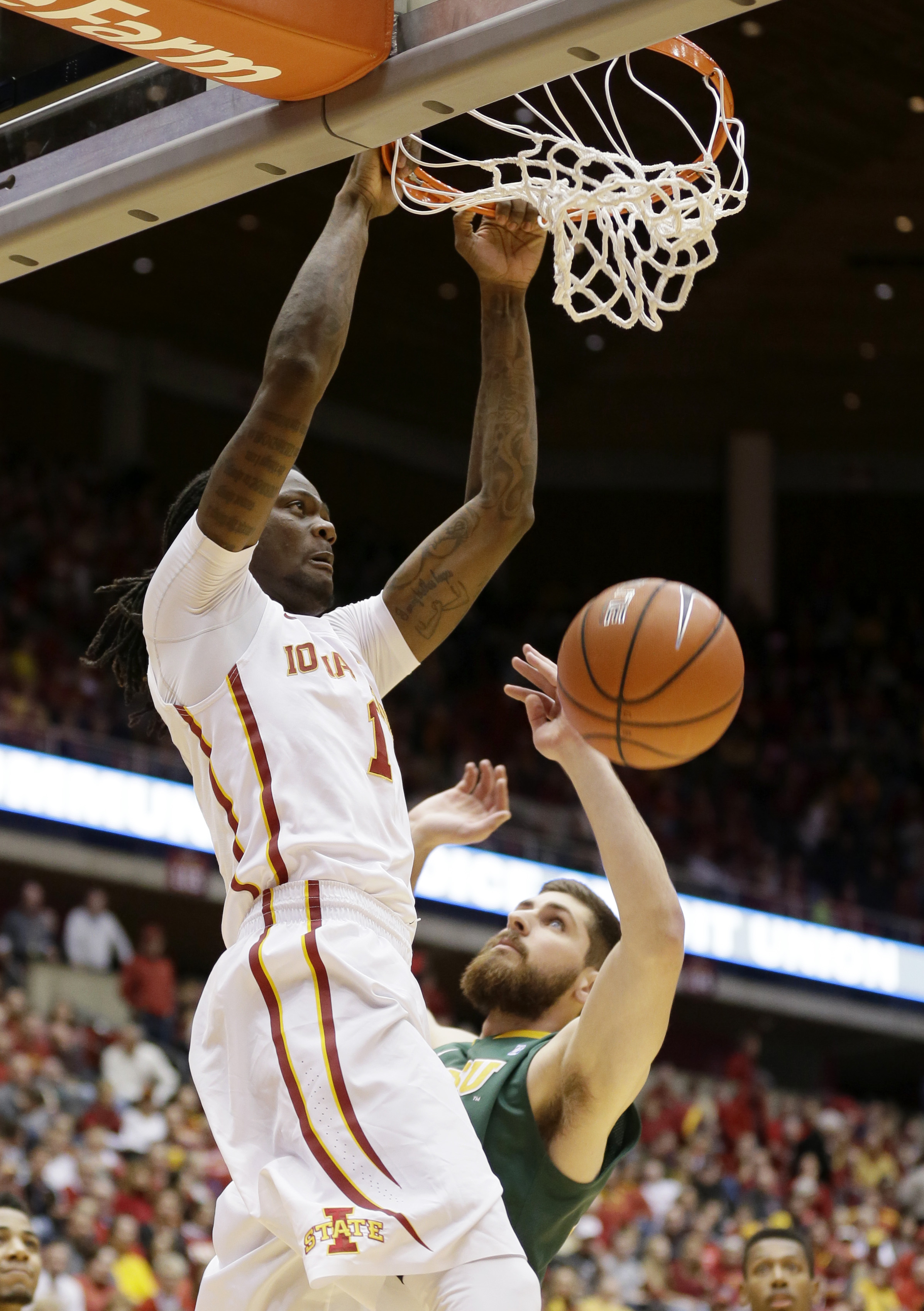Iowa State forward Jameel McKay dunks the ball over North Dakota State forward Chris Kading, right, during the first half of an NCAA college basketball game, Tuesday, Dec. 1, 2015, in Ames, Iowa. (AP Photo/Charlie Neibergall)