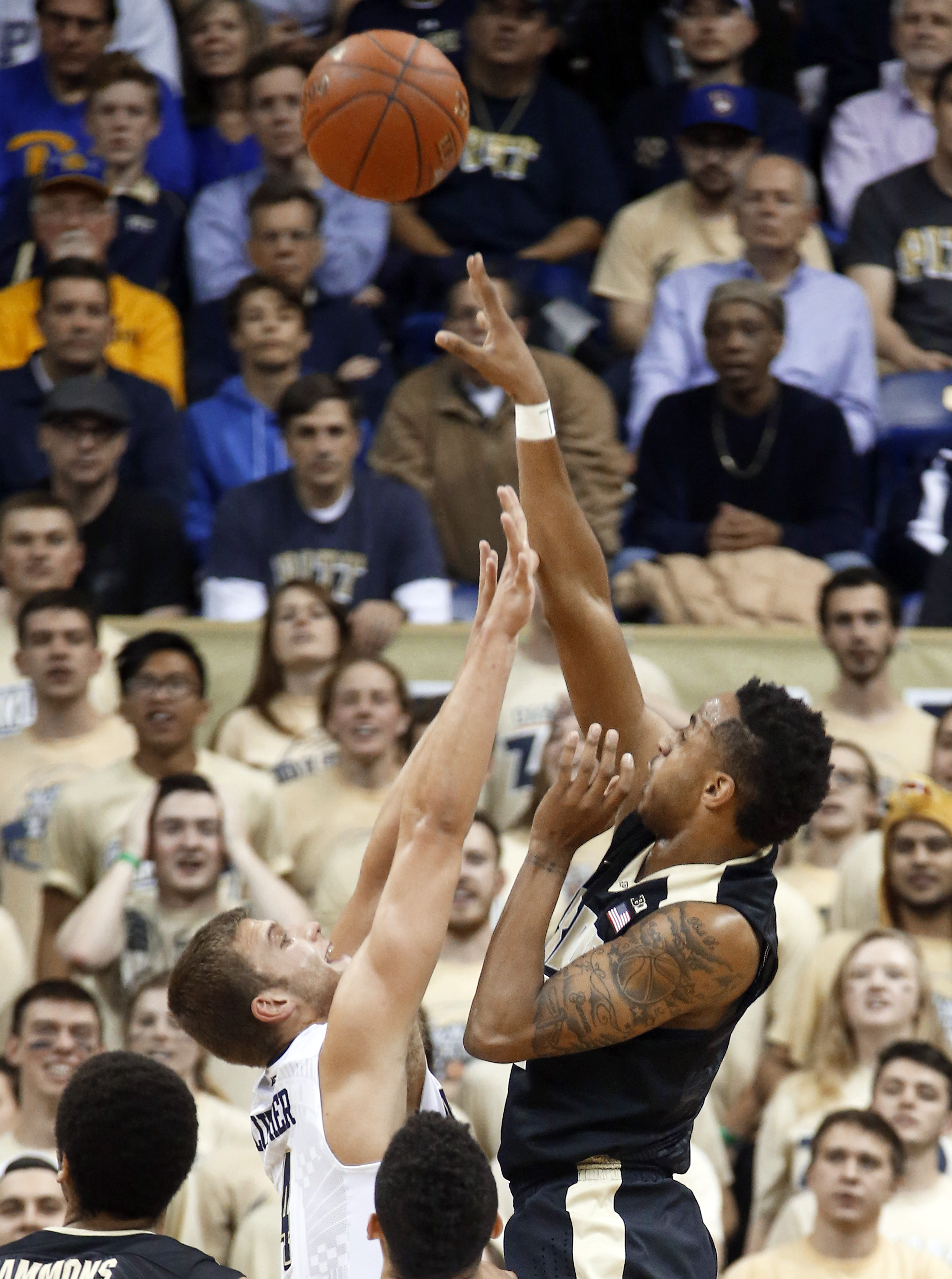 Purdue's Vince Edwards, right, shoots for three over Pittsburgh's Rafael Maia in the first half of an NCAA college basketball game, Tuesday, Dec. 1, 2015, in Pittsburgh. (AP Photo/Keith Srakocic)
