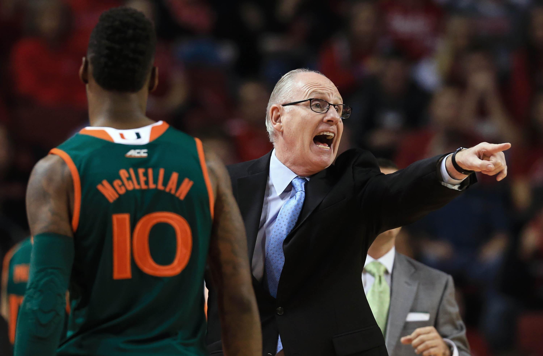 Miami coach Jim Larraaga yells instructions next to guard Sheldon McClellan (10) in the first half of an NCAA college basketball game against Nebraska in Lincoln, Neb., Tuesday, Dec. 1, 2015. (AP Photo/Nati Harnik)
