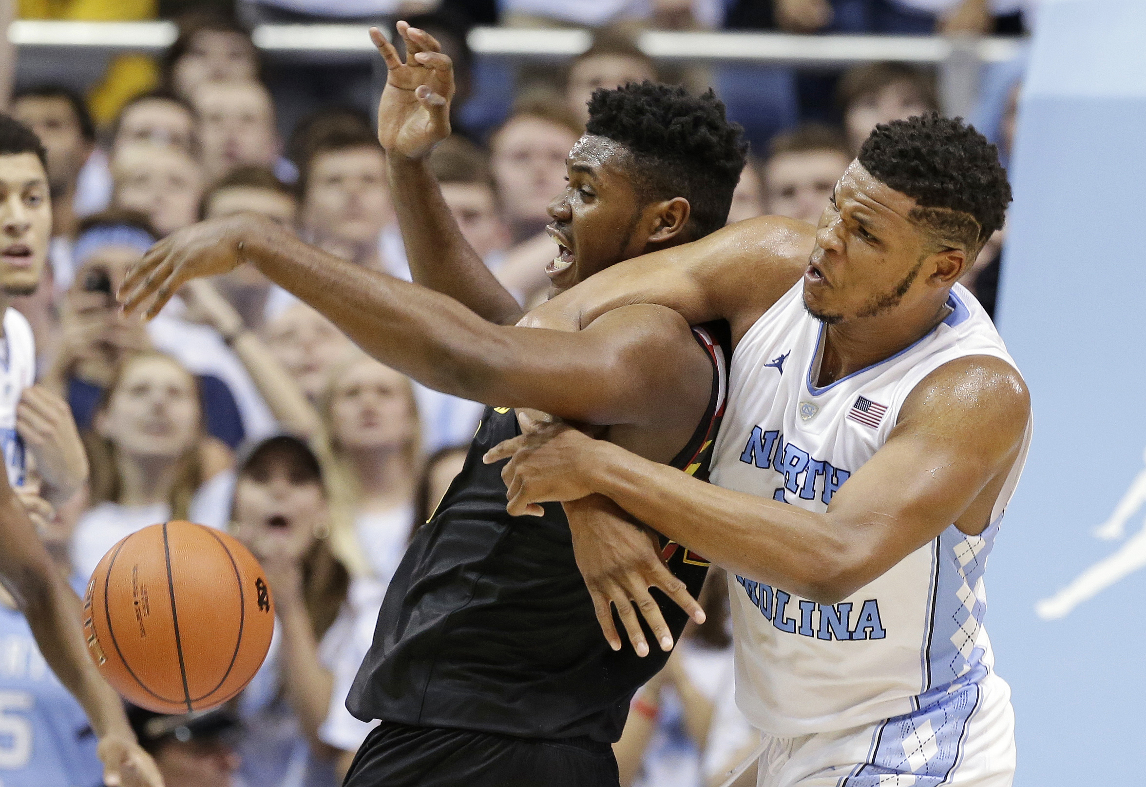 North Carolina's Kennedy Meeks, right, and Maryland's Diamond Stone vie for possession of the ball during the second half of an NCAA college basketball game in Chapel Hill, N.C., Tuesday, Dec. 1, 2015. North Carolina won 89-81. (AP Photo/Gerry Broome)