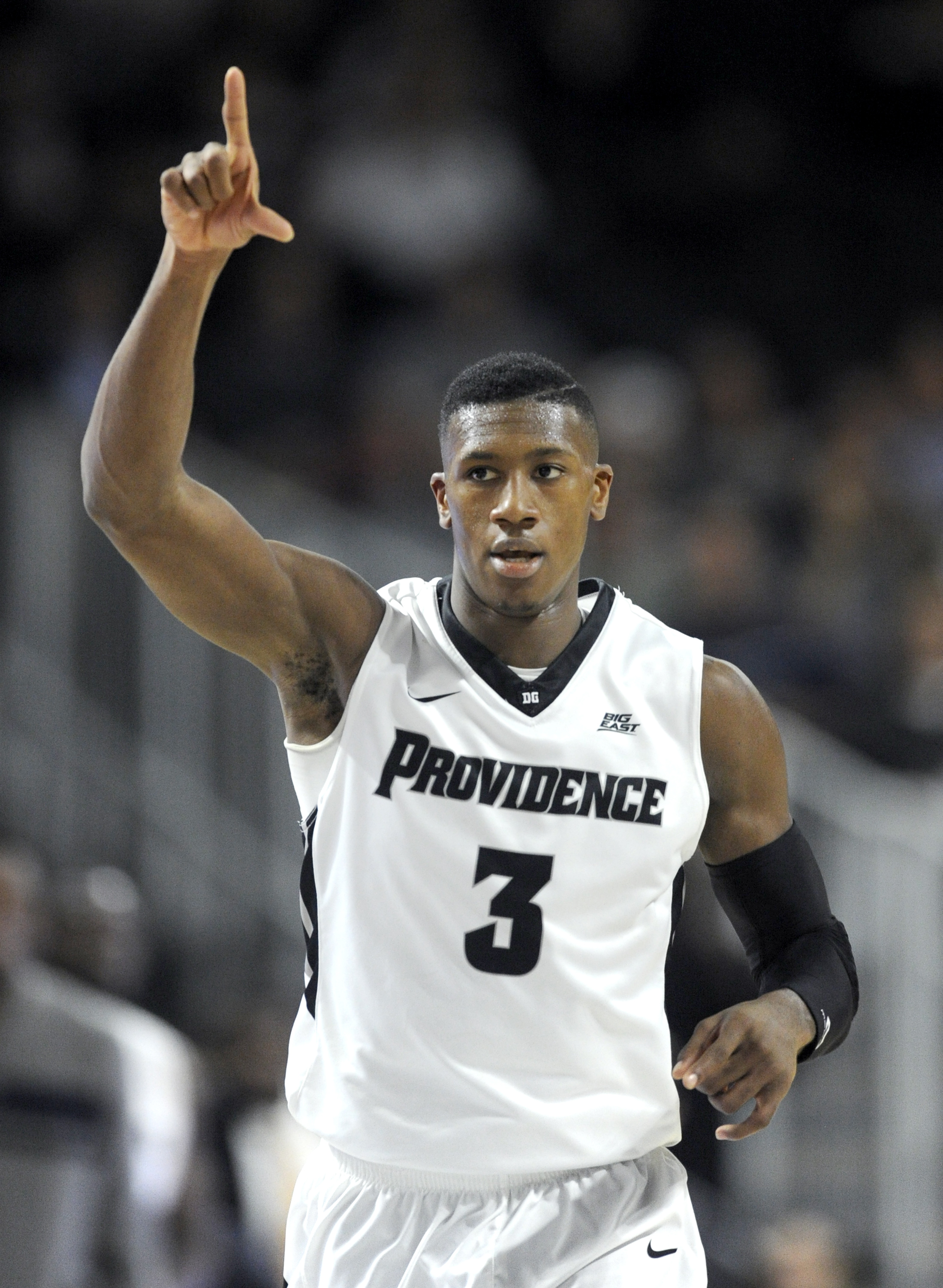 Providence guard Kris Dunn (3) celebrates getting a 3-point basket in the second half of an NCAA college basketball game against Hartford, Wednesday, Dec. 2, 2015, in Providence, R.I.  Providence won 89-66. (AP Photo/Gretchen Ertl)