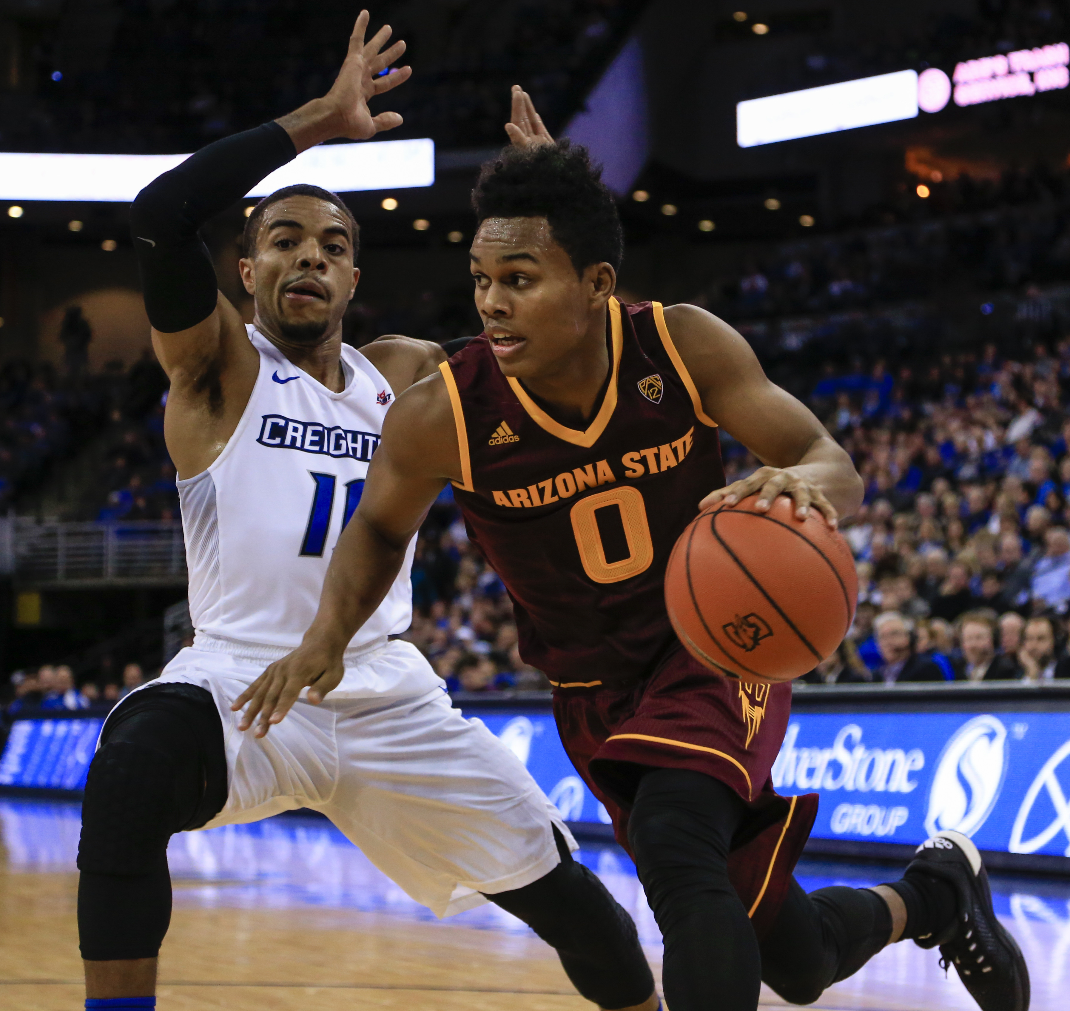 Arizona State's Tra Holder (0) drives past Creighton's Maurice Watson Jr. (10) during the first half of an NCAA college basketball game in Omaha, Neb., Wednesday, Dec. 2, 2015. (AP Photo/Nati Harnik)