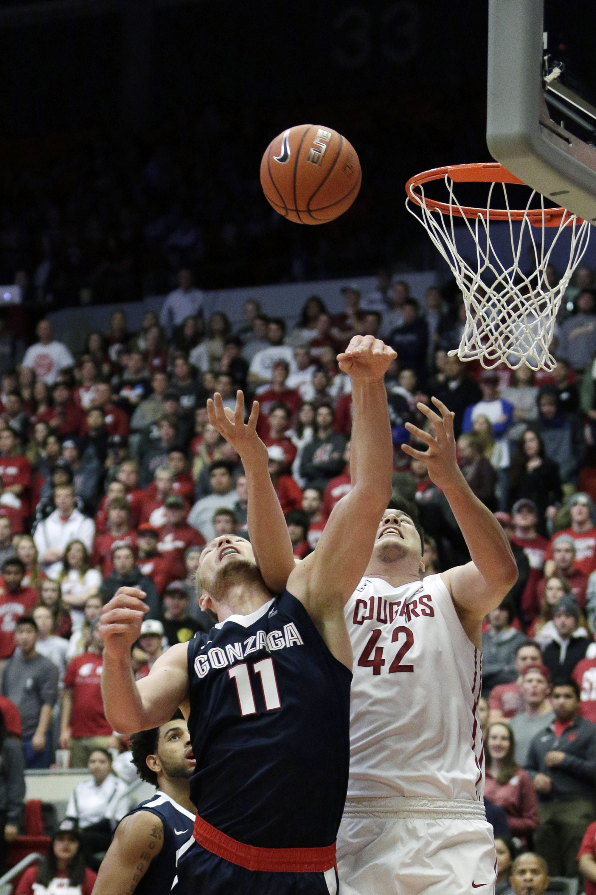 Gonzaga's Domantas Sabonis (11) and Washington State's Conor Clifford (42) go after a rebound during the first half of an NCAA college basketball game, Wednesday, Dec. 2, 2015, in Pullman, Wash. (AP Photo/Young Kwak)