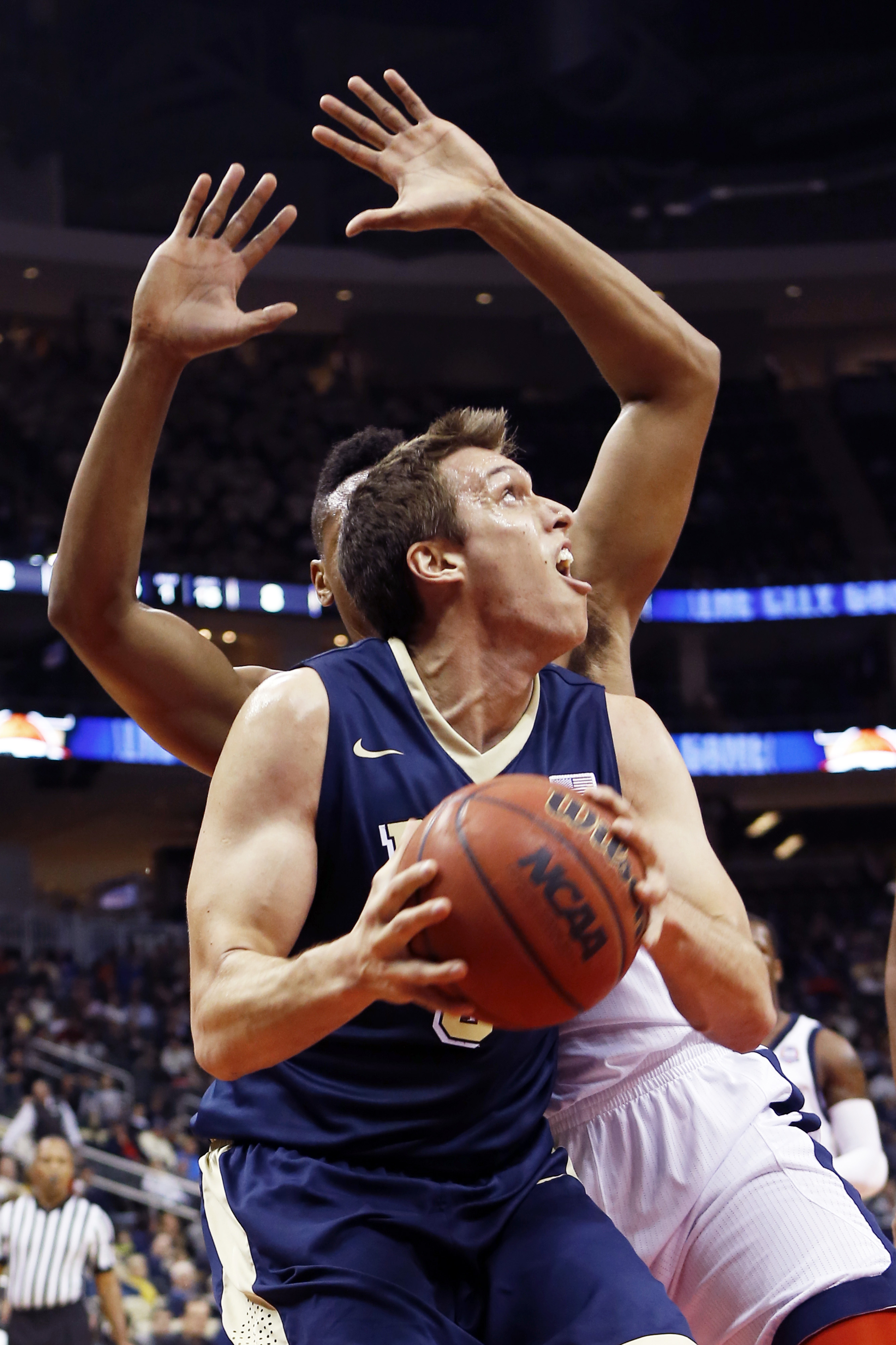Pittsburgh's Rafael Maia looks to shoot as Duquesne's L.G. Gill defends in the first half of an NCAA college basketball game, Friday, Dec. 4, 2015, in Pittsburgh. (AP Photo/Keith Srakocic)