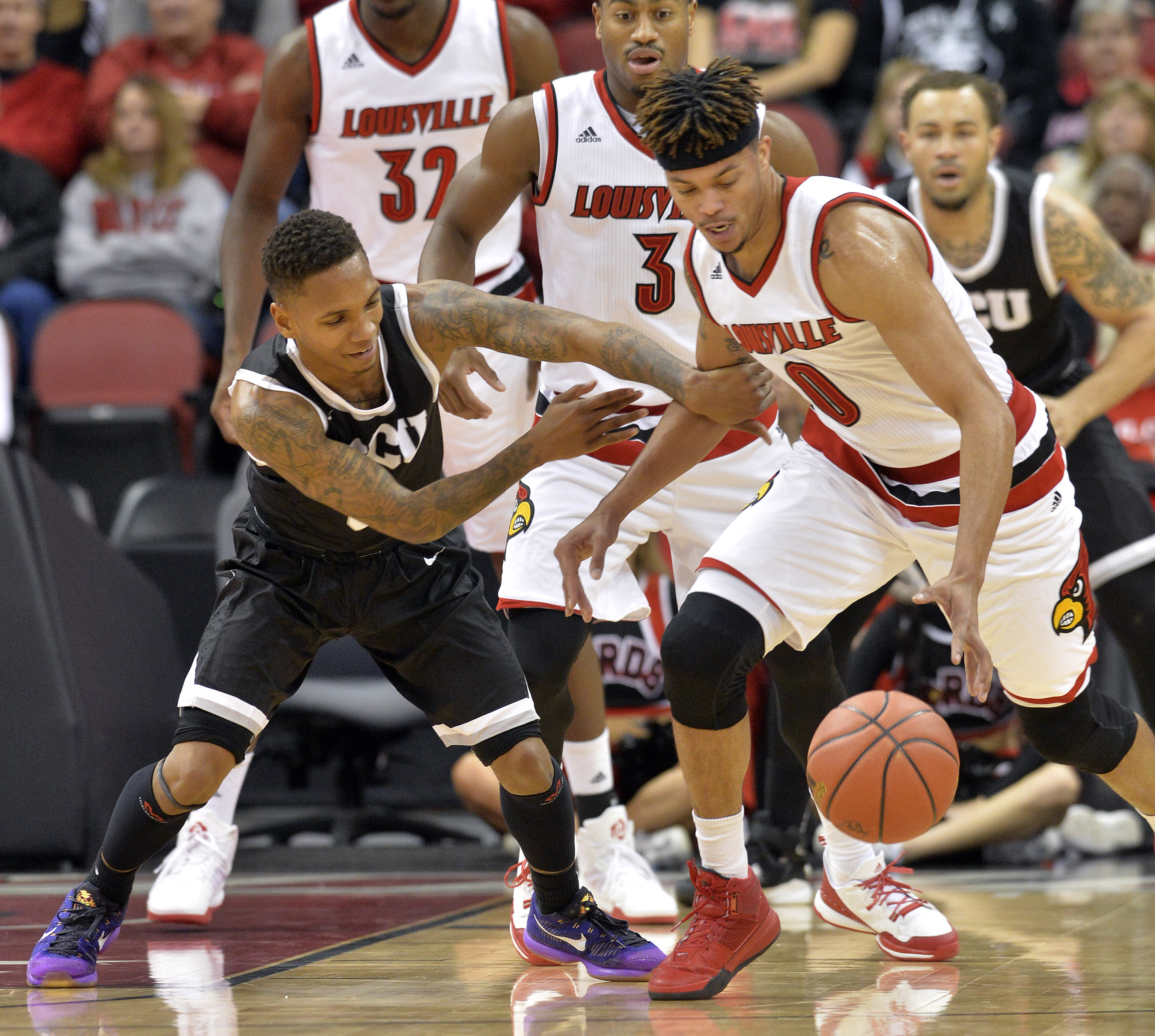 Louisville's Damion Lee (0) battles with Grand Canyon's DeWayne Russell (0) for a loose ball during the first half of an NCAA college basketball game, Saturday, Dec. 5, 2015, in Louisville, Ky. (AP Photo/Timothy D. Easley)