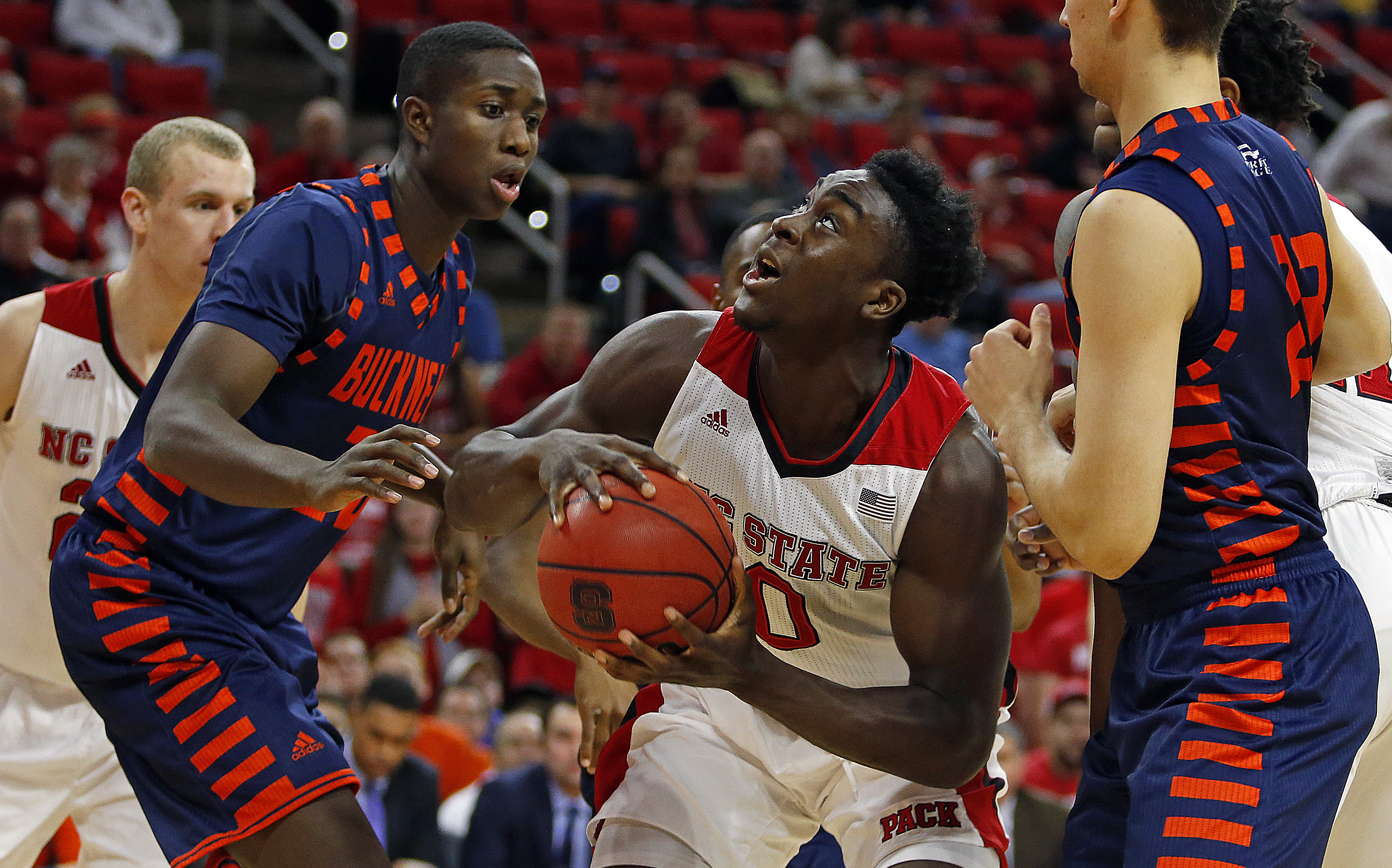 North Carolina State's Abdul-Malik Abu (0) battles between Bucknell's Nana Foulland (20) and Zach Thomas (23) during the first half of an NCAA college basketball game in Raleigh, N.C., Saturday, Dec. 5, 2015. (AP Photo/Karl B DeBlaker)