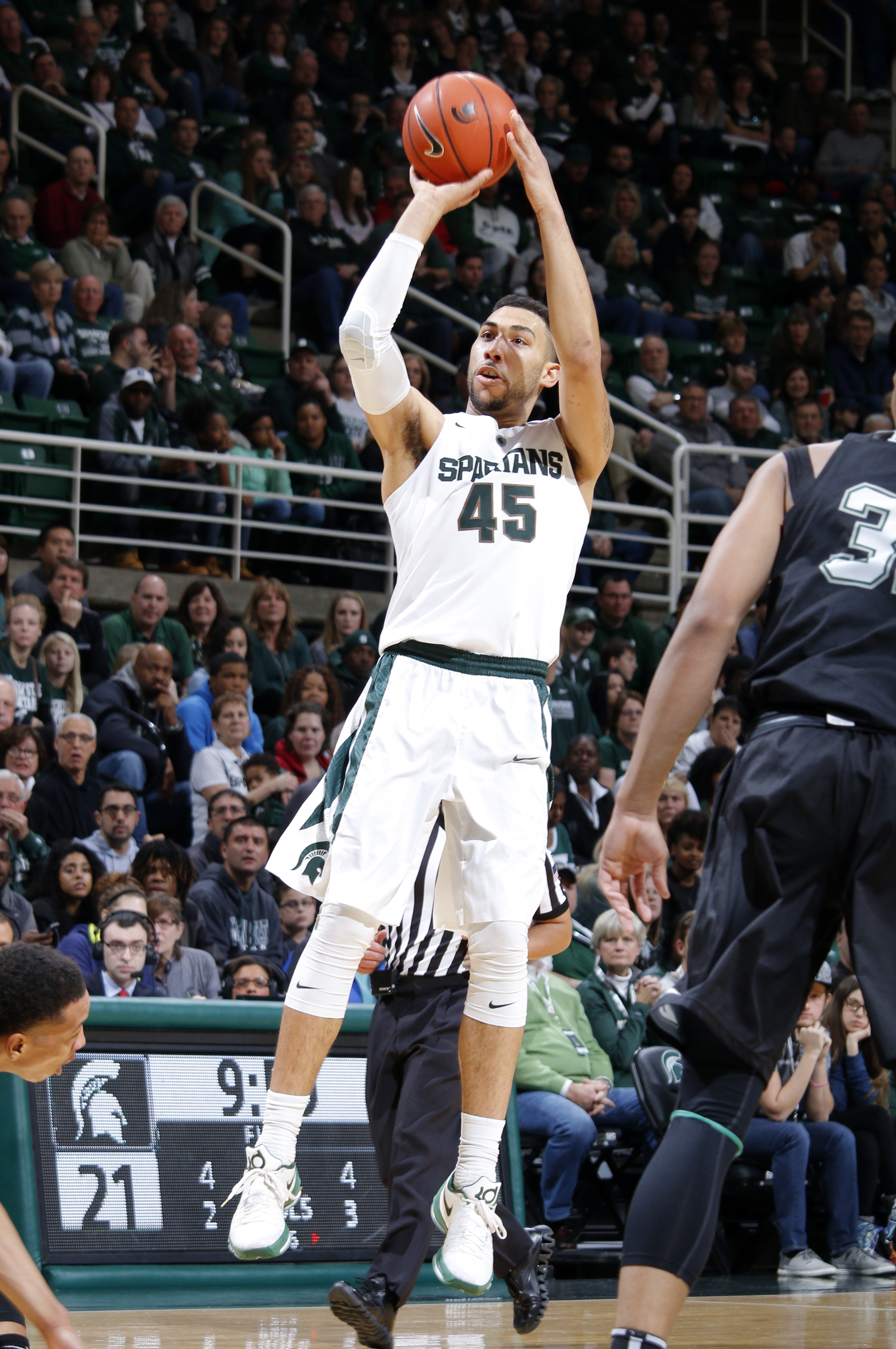 Michigan State's Denzel Valentine (45) shoots against Binghamton during the first half of an NCAA college basketball game, Saturday, Dec. 5, 2015, in East Lansing, Mich. (AP Photo/Al Goldis)