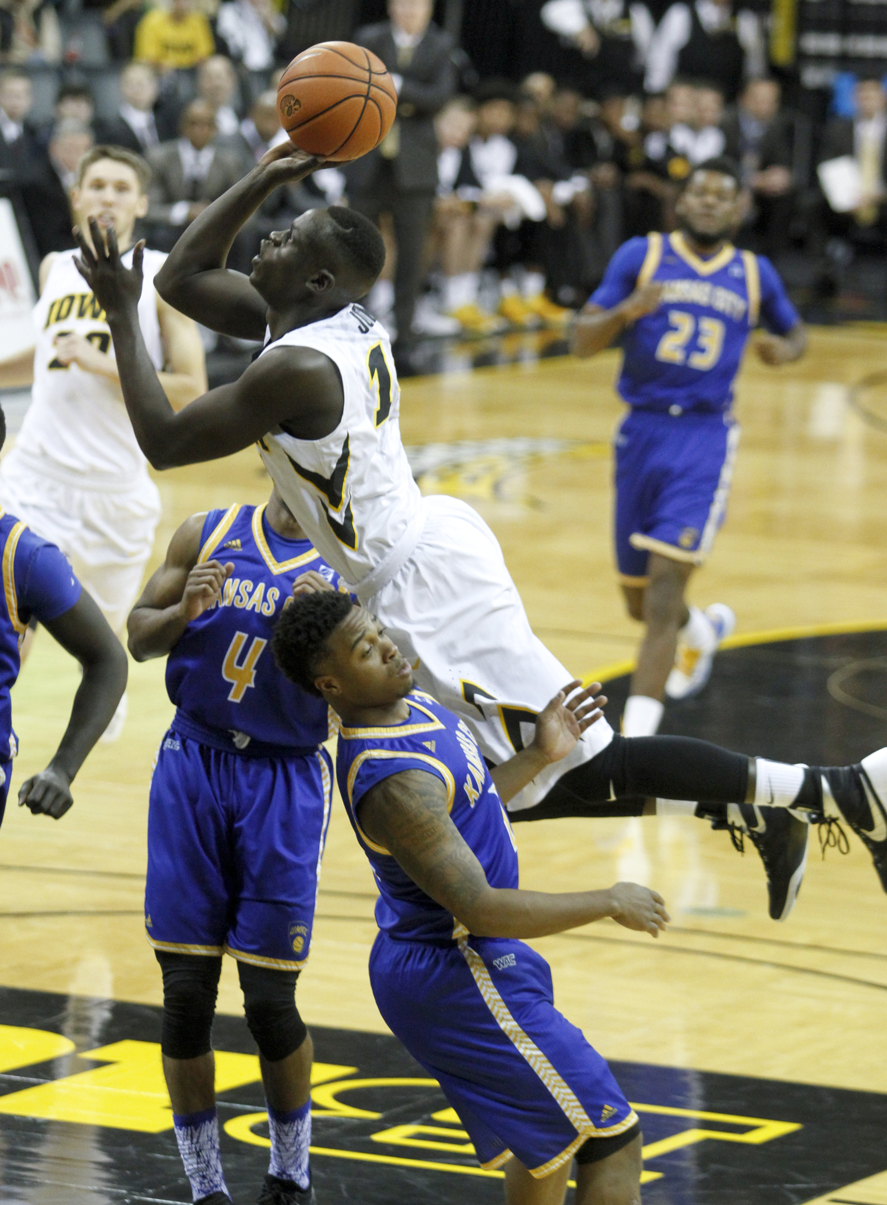 Iowa guard Peter Jok (14) drives to the basket against UMKC guard Martez Harrison (12) during the first half of an NCAA college basketball game in Iowa City, Iowa, Saturday Dec. 5, 2015. (AP Photo/Matthew Holst)