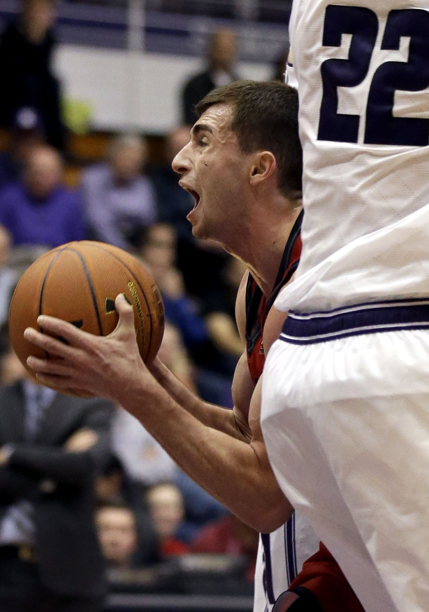 SIU - Edwardsville guard Burak Eslik, left, drives to the basket between Northwestern center Alex Olah and forward Nathan Taphorn during the first half of an NCAA college basketball game on Saturday, Dec. 5, 2015, in Evanston, Ill. (AP Photo/Nam Y. Huh)