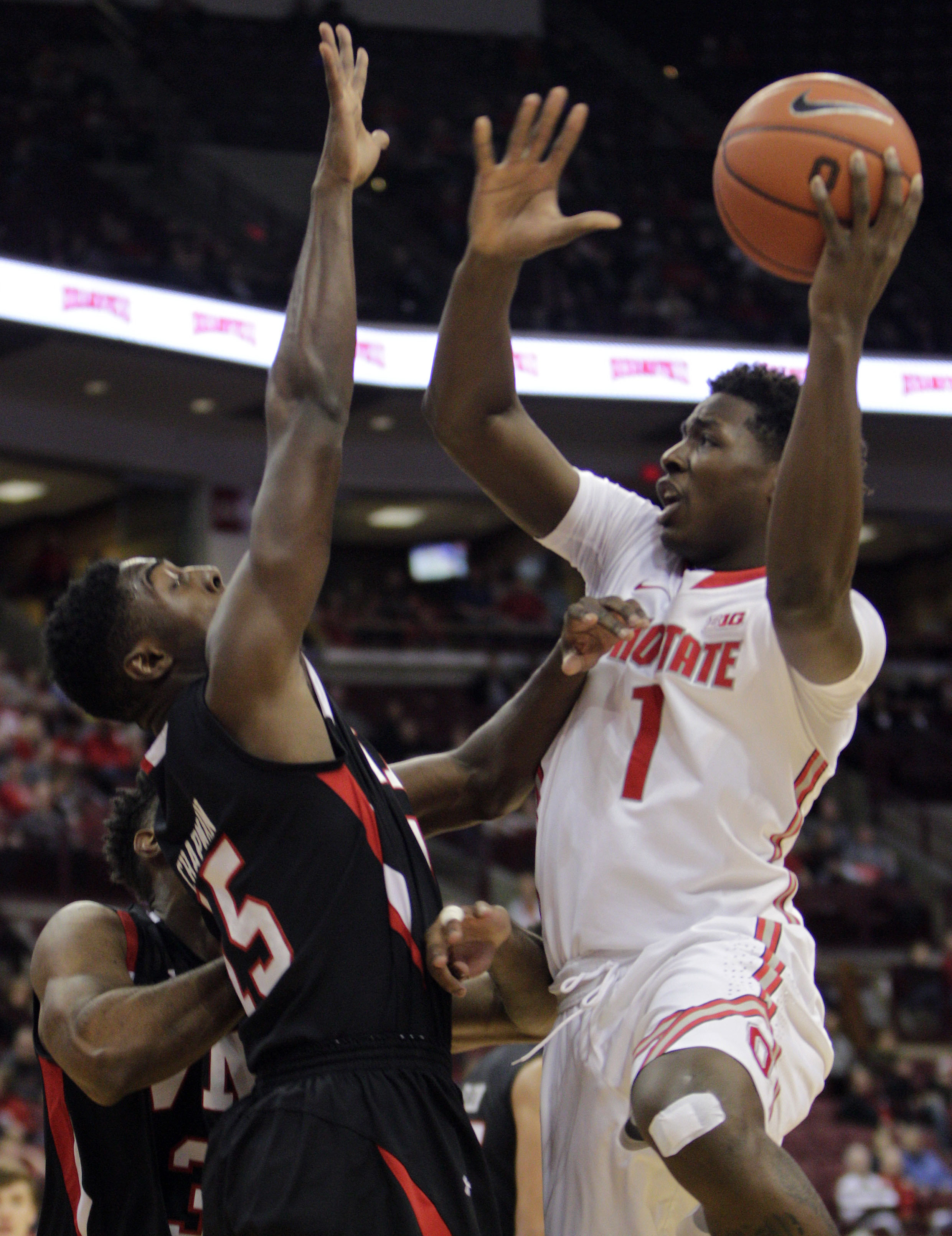 Ohio State's Jai'Sean Tate, right, shoots over VMI's Trey Chapman, left, during the first half of an NCAA college basketball game Saturday, Dec. 5, 2015, in Columbus, Ohio. (AP Photo/Jay LaPrete)