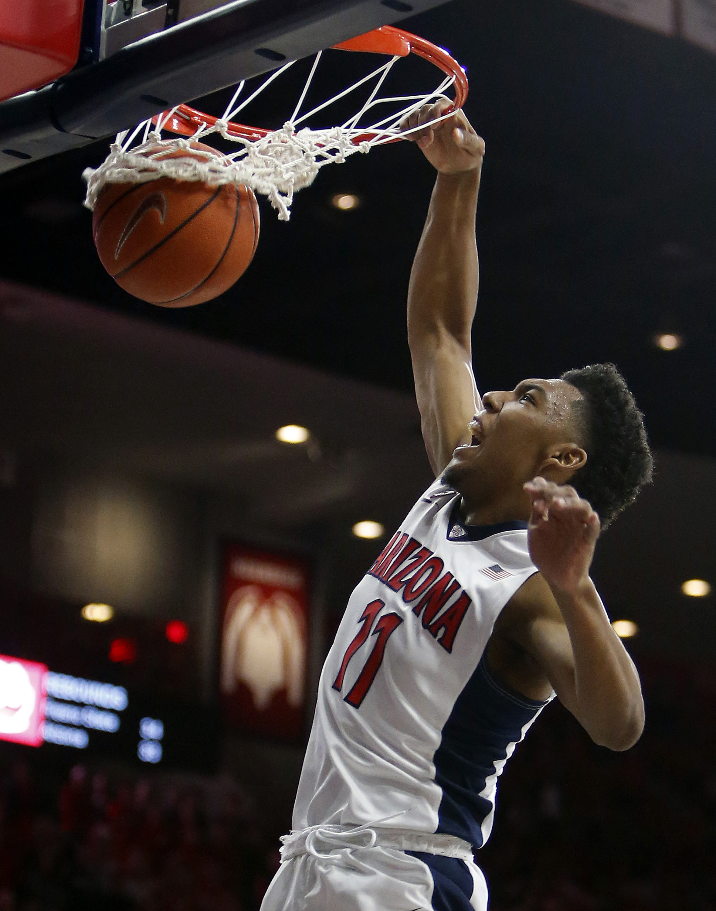 Arizona guard Allonzo Trier dunks the ball during the second half of an NCAA college basketball game against Fresno State, Wednesday, Dec. 9, 2015, in Tucson, Ariz. (AP Photo/Rick Scuteri)