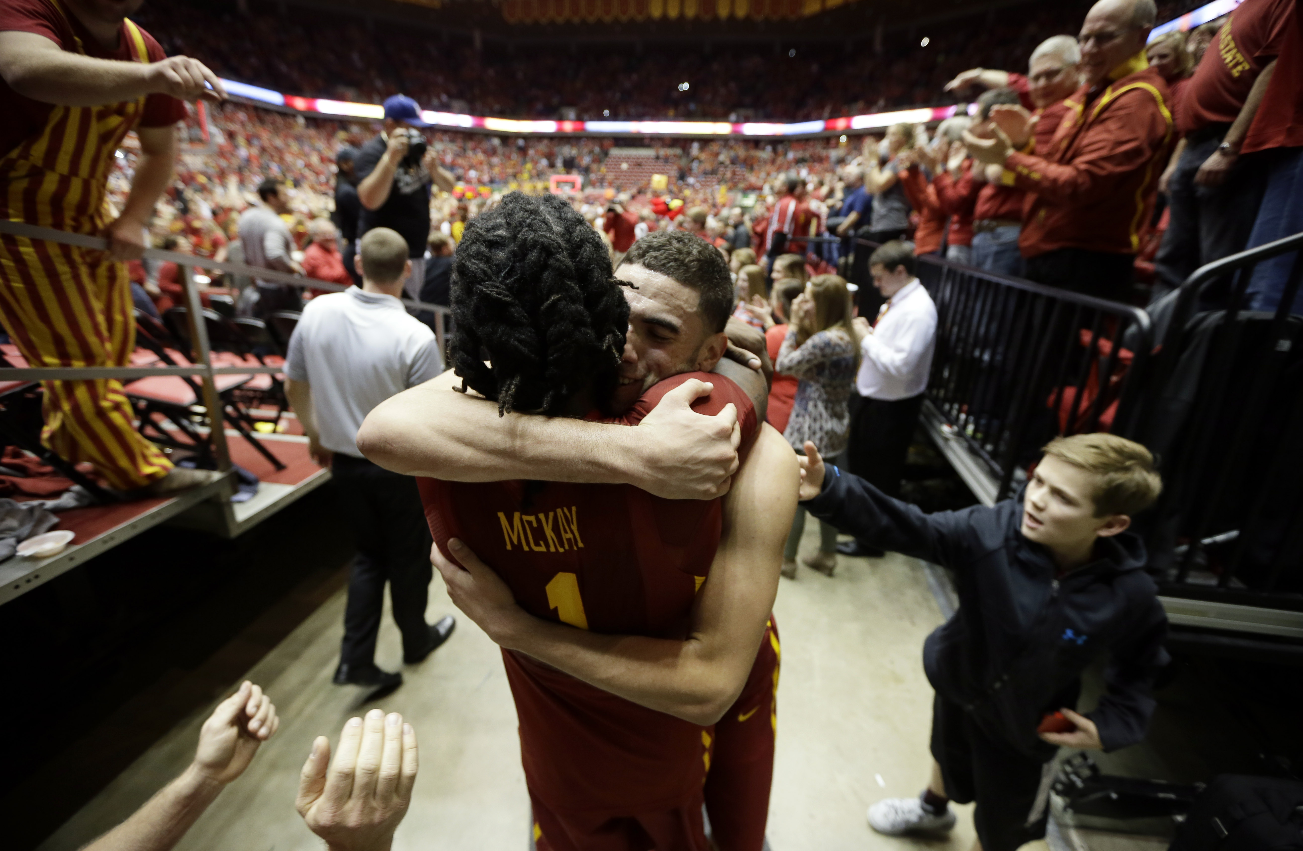 Iowa State forward Georges Niang celebrates with teammate Jameel McKay, left, after an NCAA college basketball game against Iowa, Thursday, Dec. 10, 2015, in Ames, Iowa. Iowa State won 83-82. (AP Photo/Charlie Neibergall)