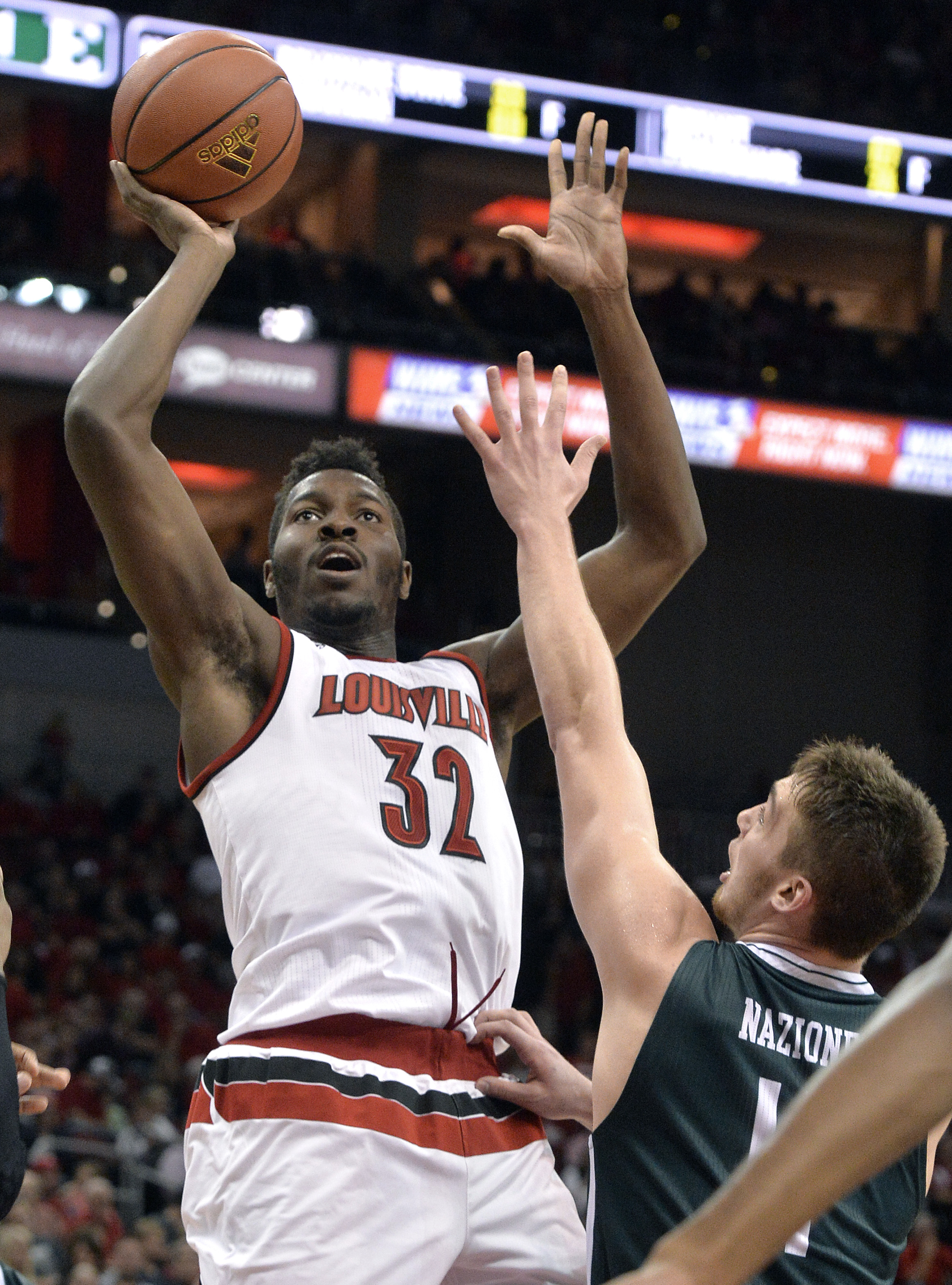 Louisville's Chinanu Onuaku (32) puts up a shot over the defense of Eastern Michigan's Brandon Nazione (4) during the second half of an NCAA college basketball game, Saturday, Dec. 12, 2015, in Louisville, Ky. Louisville won 86-53. (AP Photo/Timothy D. Ea