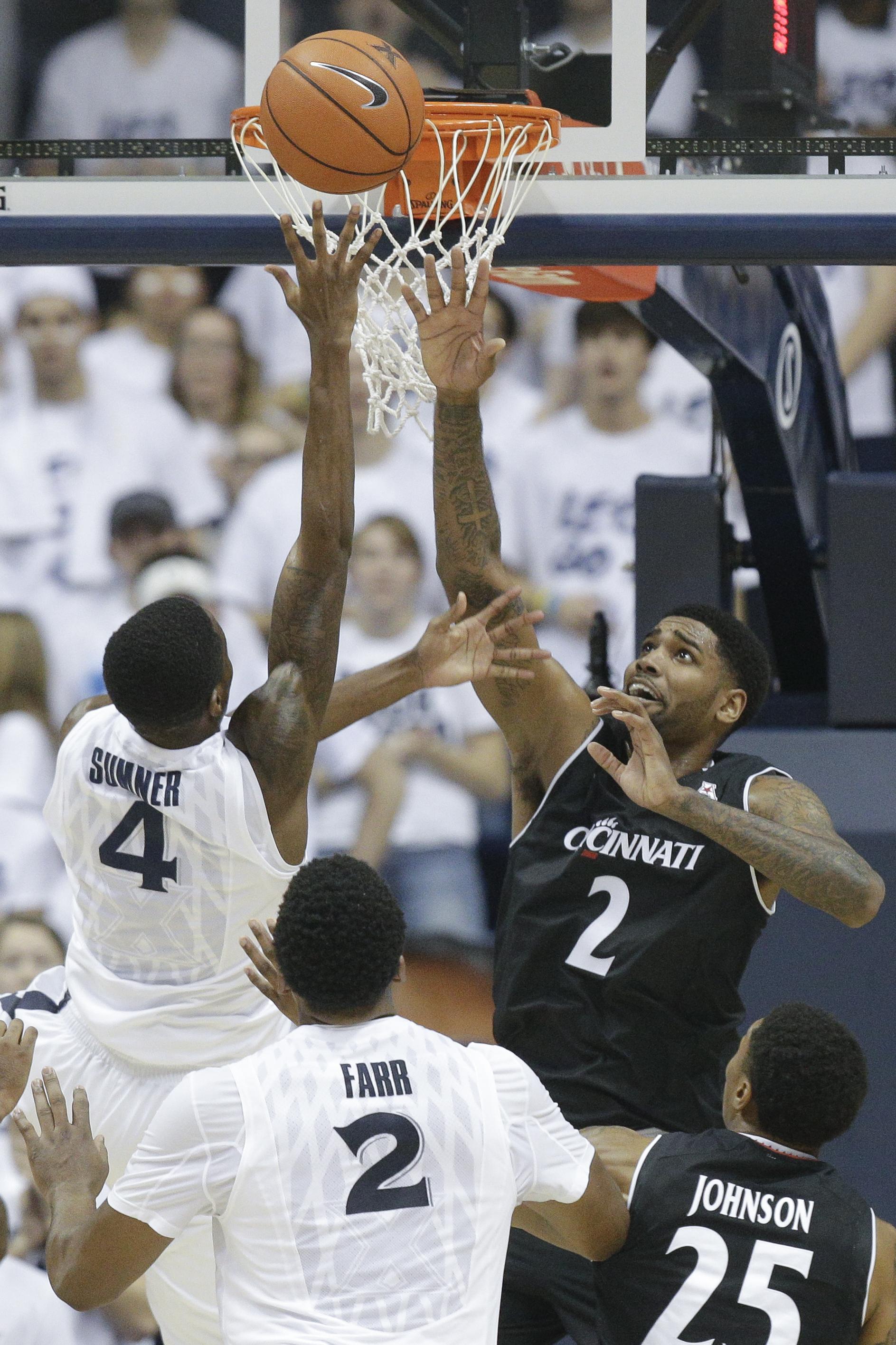 Xavier's Edmond Sumner (4) shoots over Cincinnati's Octavius Ellis (2) in the first half of an NCAA college basketball game, Saturday, Dec. 12, 2015, in Cincinnati. (AP Photo/John Minchillo)