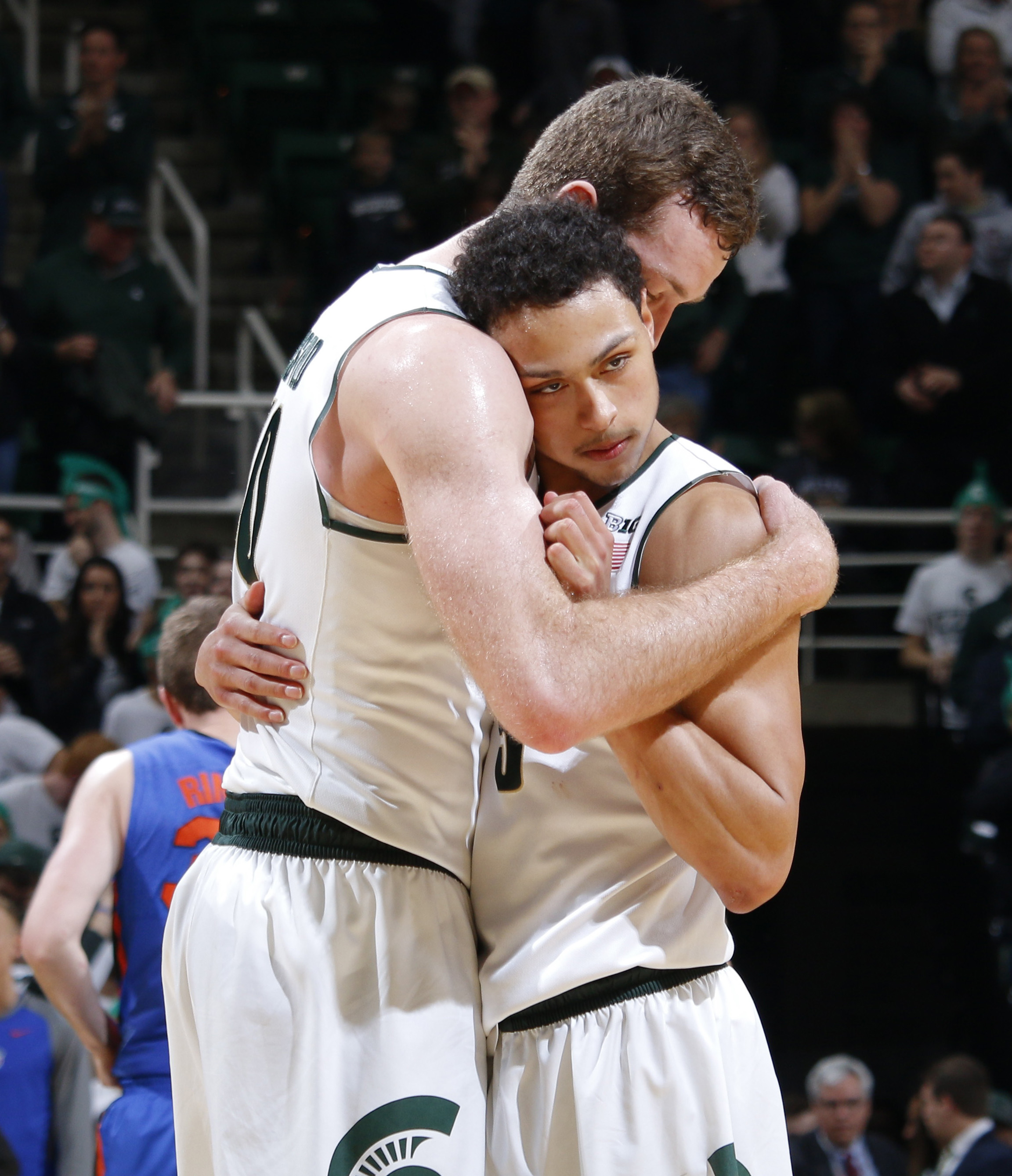Michigan State's Bryn Forbes, right, and Matt Costello embrace following their 58-52 win over Florida in an NCAA college basketball game, Saturday, Dec. 12, 2015, in East Lansing, Mich. (AP Photo/Al Goldis)