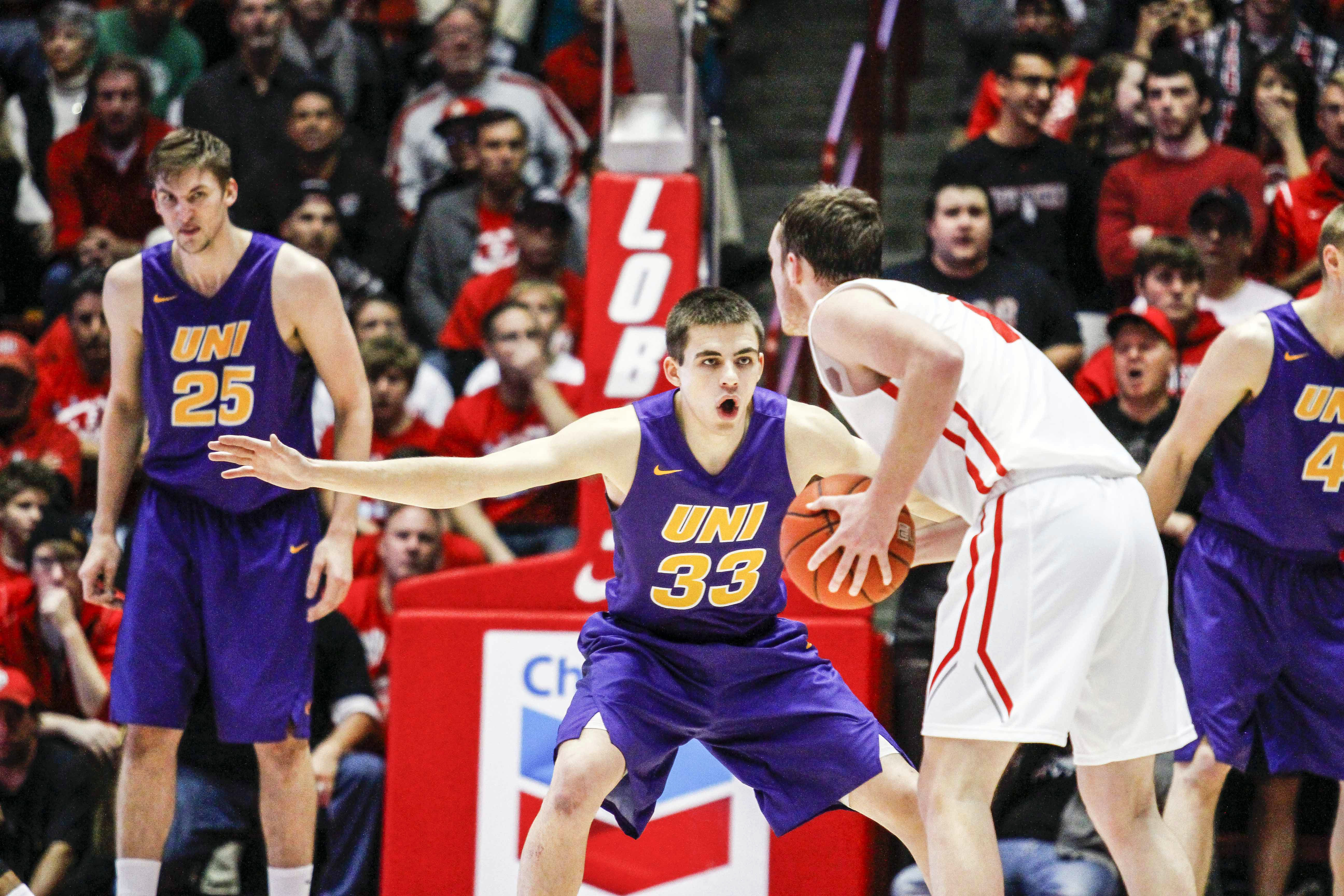 Northern Iowa's Wyatt Lohaus (33) guards New Mexico's Cullen Neal (1) during the first half an NCAA college basketball game, Saturday, Dec. 12, 2015, in Albuquerque, N.M. (AP Photo/Juan Labreche)