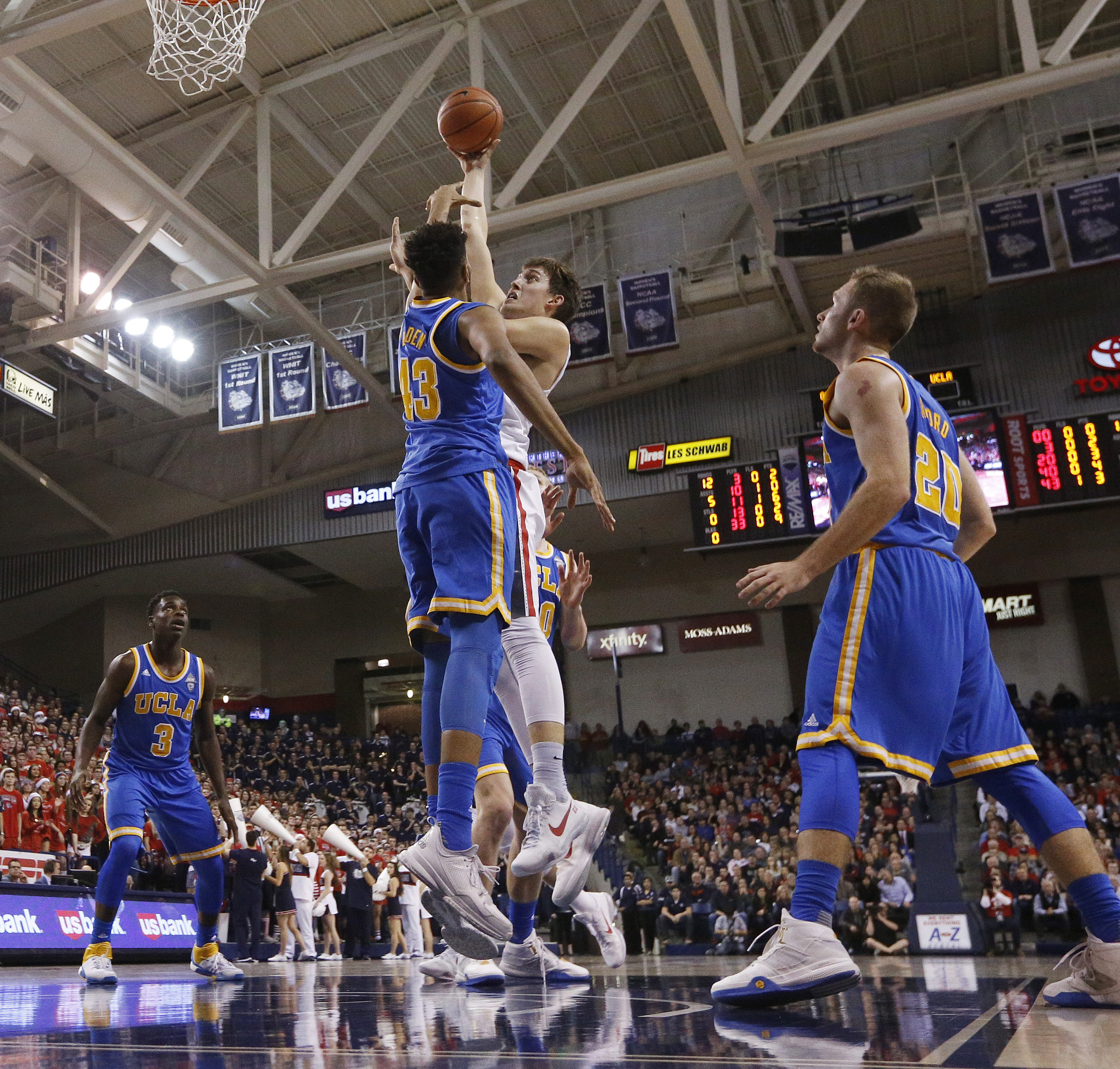 UCLA's Jonah Bolden (43) defends Gonzaga's Kyle Wiltjer during the first half of an NCAA college basketball game, Saturday, Dec. 12, 2015, in Spokane, Wash. (AP Photo/Young Kwak)