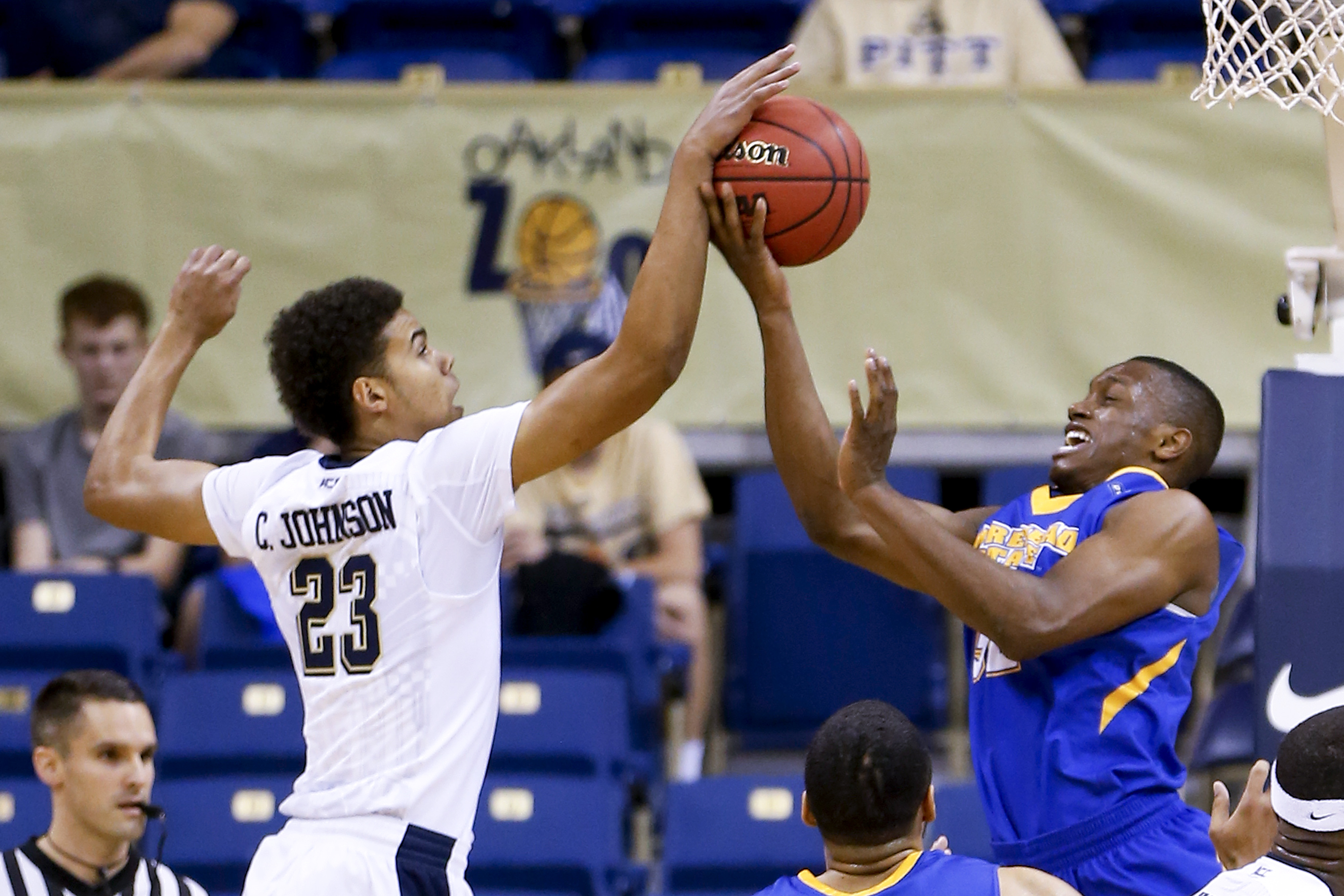 Pittsburgh's Cameron Johnson (23) blocks a shot by Morehead State's Brent Arrington in the first half of an NCAA college basketball game, Sunday, Dec. 13, 2015, in Pittsburgh. (AP Photo/Keith Srakocic)