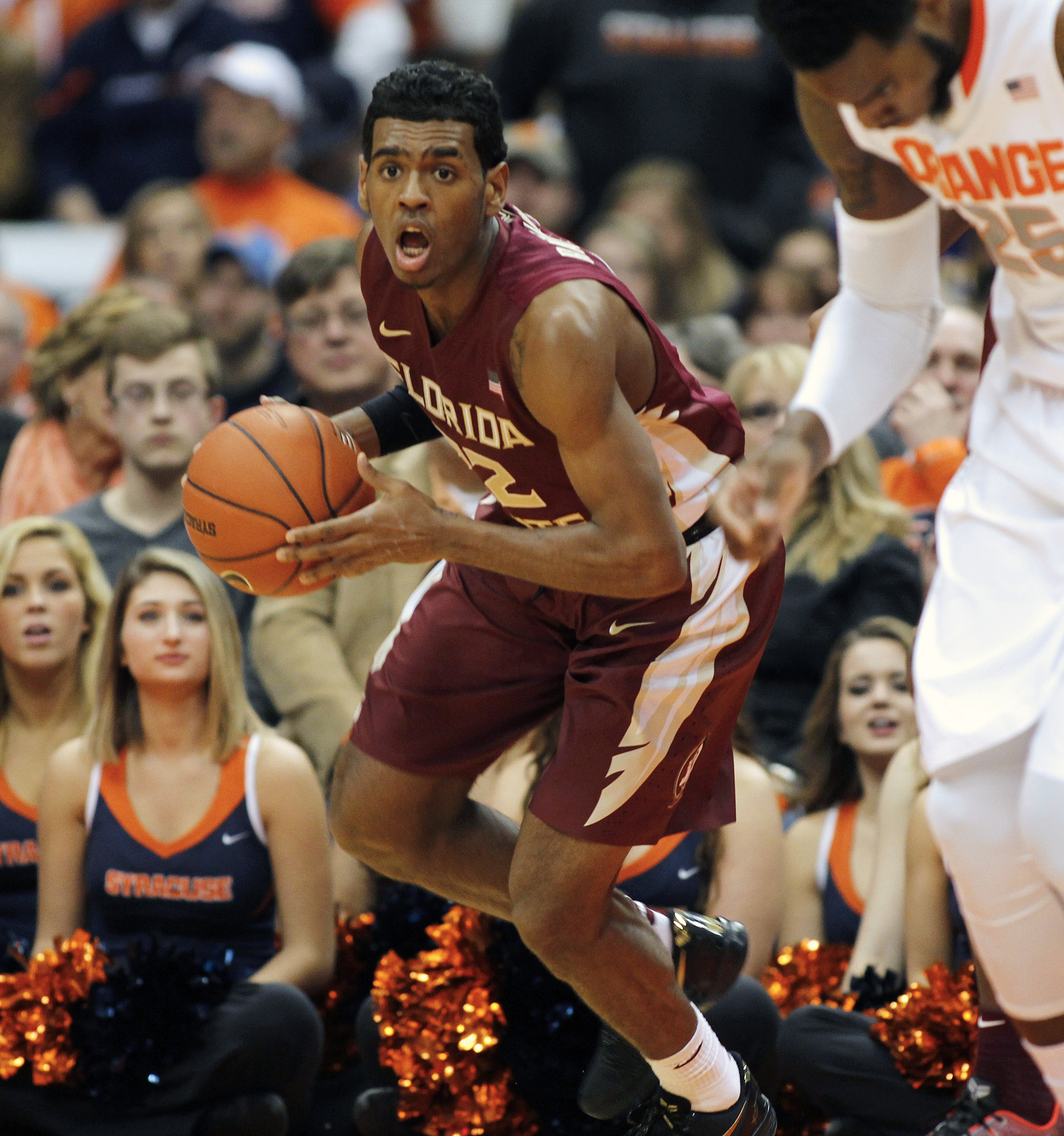 FILE - In this Jan. 11, 2015, file photo, Florida State's Xavier Rathan-Mayes looks to pass the ball down court in the first half of an NCAA college basketball game against Syracuse in Syracuse, N.Y. Xavier Rathan-Mayes maturity as a point guard has gone