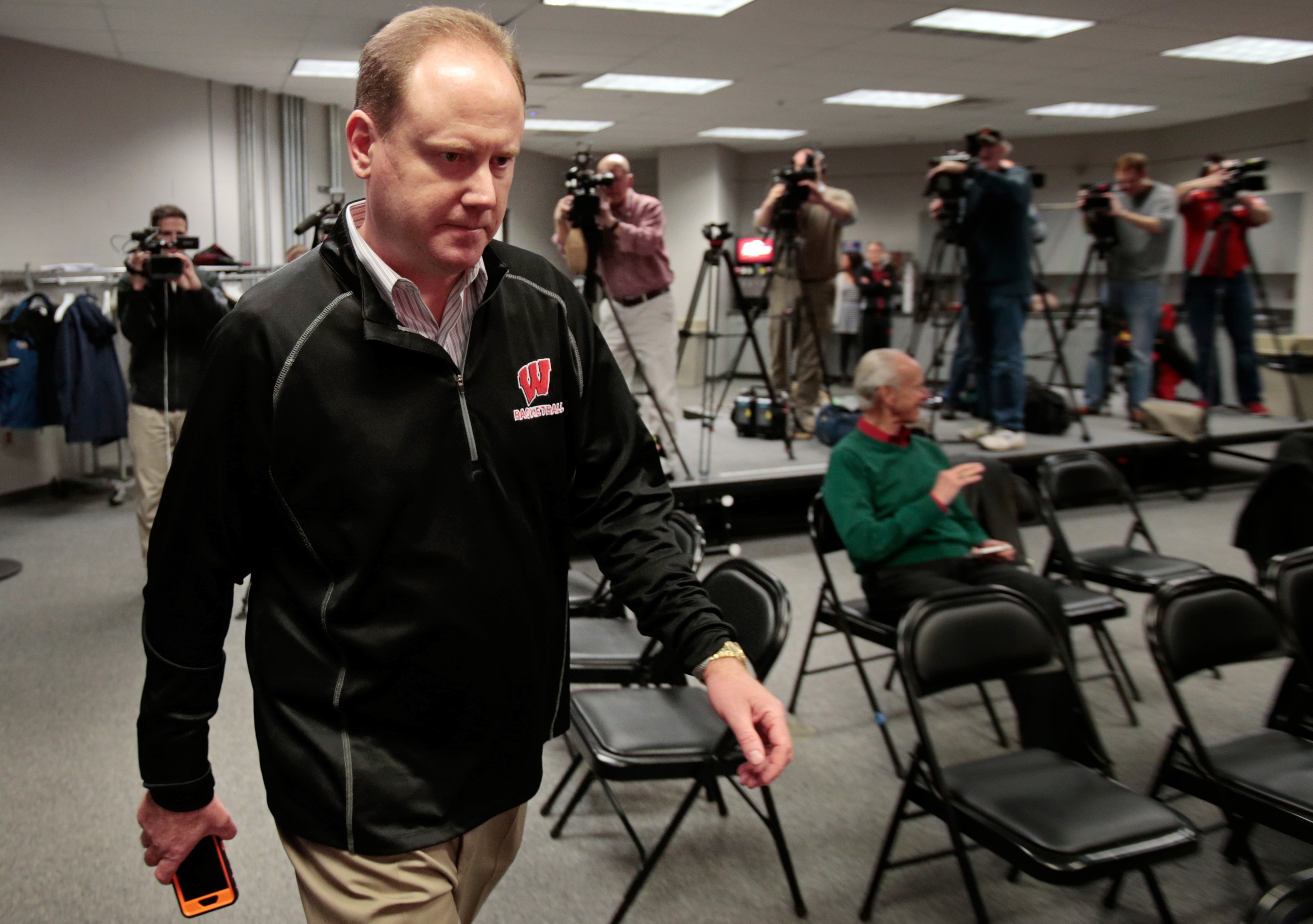 Wisconsin interim head coach Greg Gard arrives for an NCAA college basketball press conference at the Kohl Center in Madison, Wis., Wednesday, Dec. 16, 2015. Bo Ryan, the team's head coach since 2001, announced his retirement Tuesday after his team's win