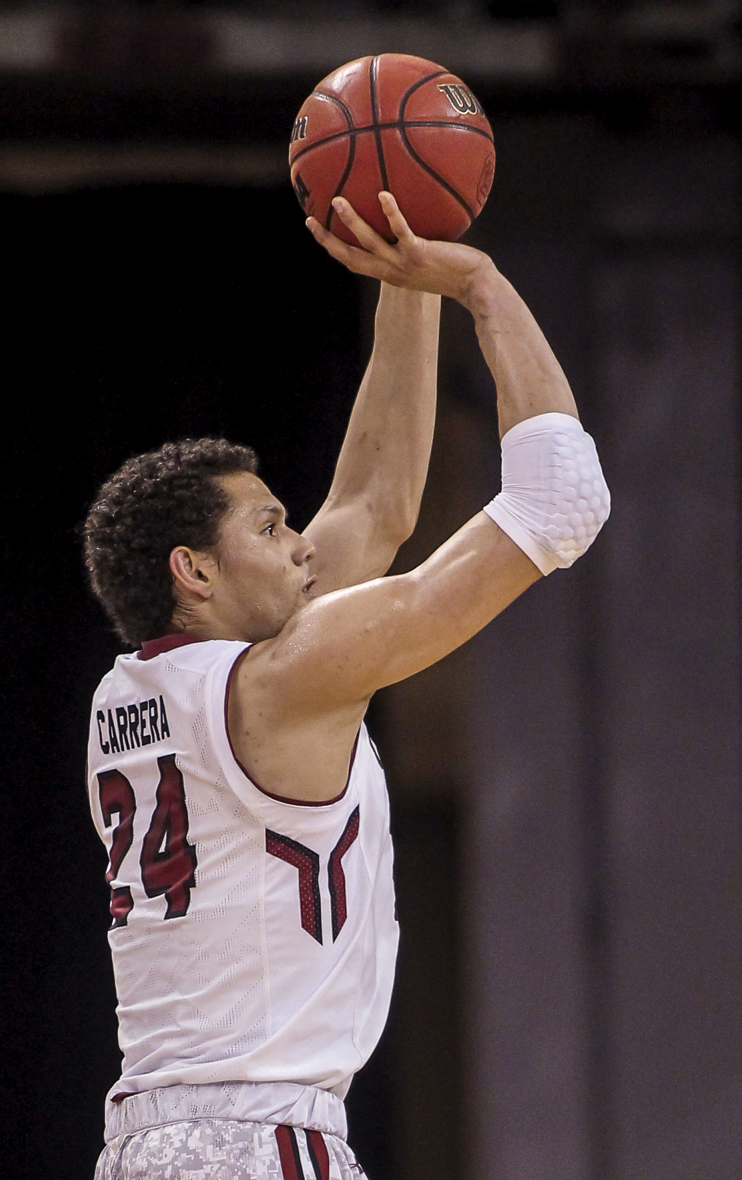 In this March 5, 2015 photo, South Carolina's Michael Carrera shoots against Arkansas during an NCAA college basketball game in Columbia, S.C. (AP Photo/Travis Bell)