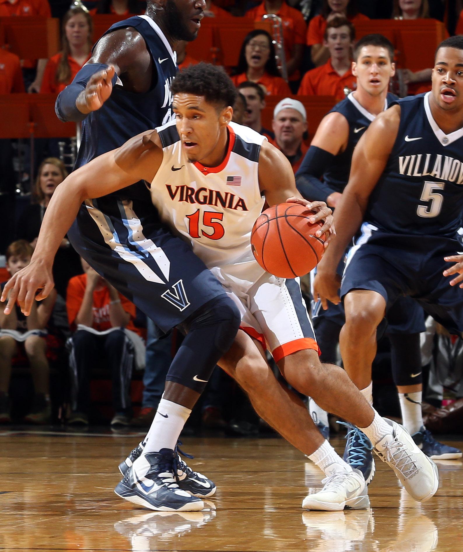 Virginia guard Malcolm Brogdon (15) runs into Villanova forward Daniel Ochefu (23) during an NCAA basketball game Saturday Dec. 19, 2015, in Charlottesville, Va. (AP Photo/Andrew Shurtleff)