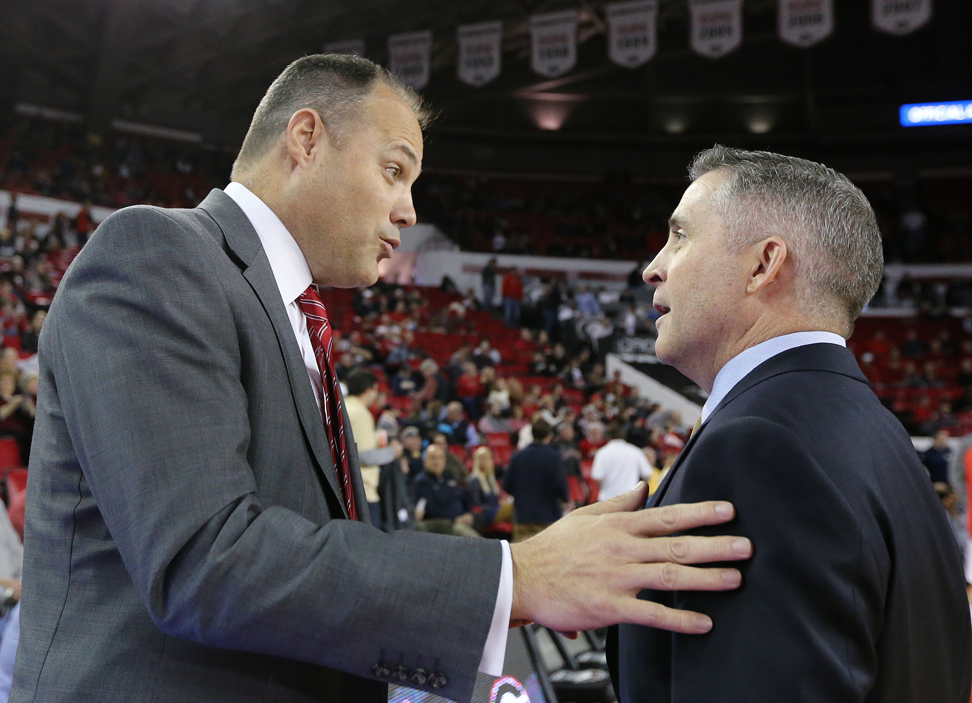 Georgia head coach Mark Fox, left, and Georgia Tech head coach Brian Gregory exchange greetings before the start of an NCAA college basketball game in Athens, Ga.  (Curtis Compton/Atlanta Journal-Constitution via AP)  MARIETTA DAILY OUT; GWINNETT DAILY PO