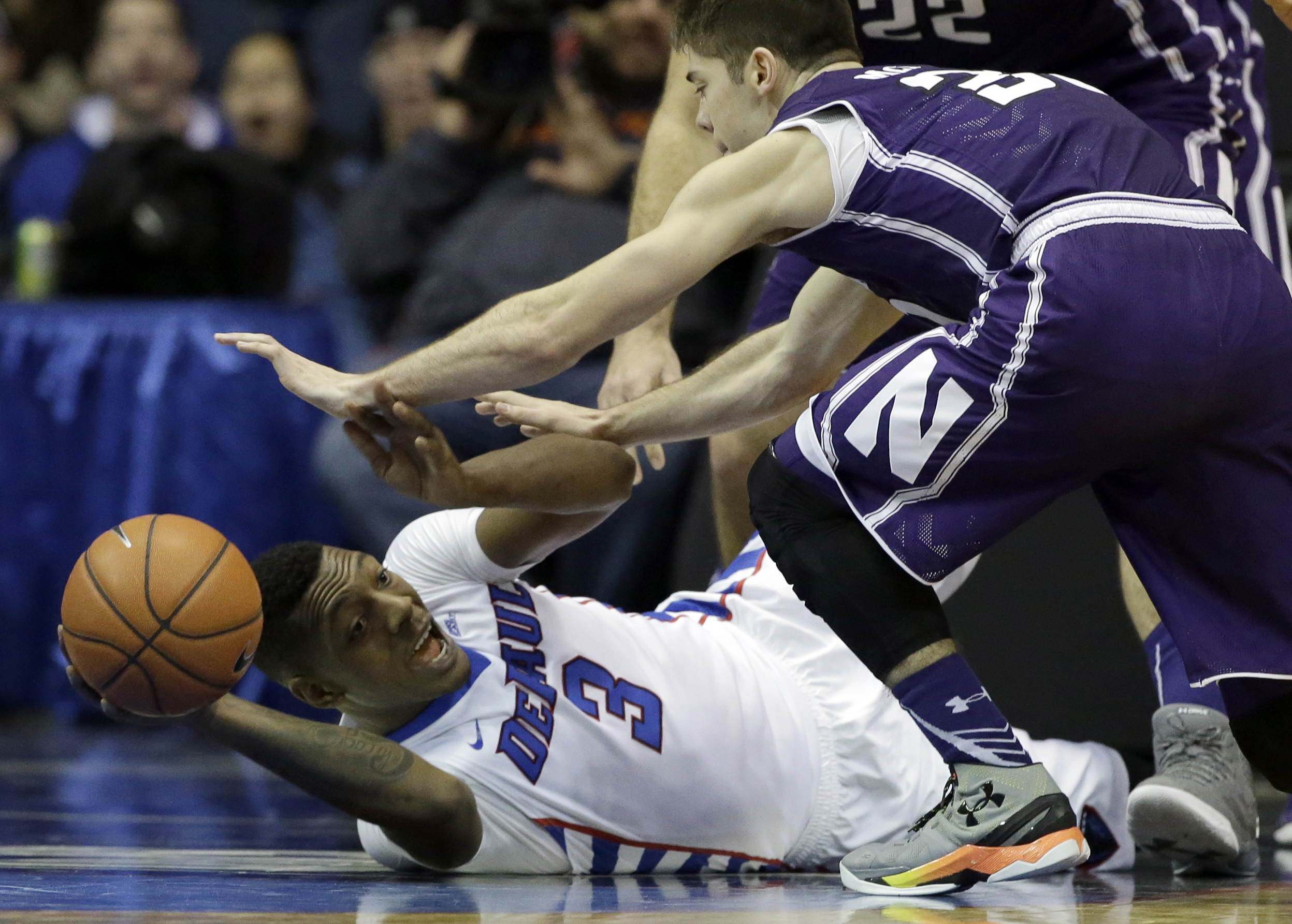 DePaul forward Rashaun Stimage, left, looks to pass against Northwestern guard Bryant McIntosh during the first half of an NCAA college basketball game on Saturday, Dec. 19, 2015, in Rosemont, Ill. (AP Photo/Nam Y. Huh)