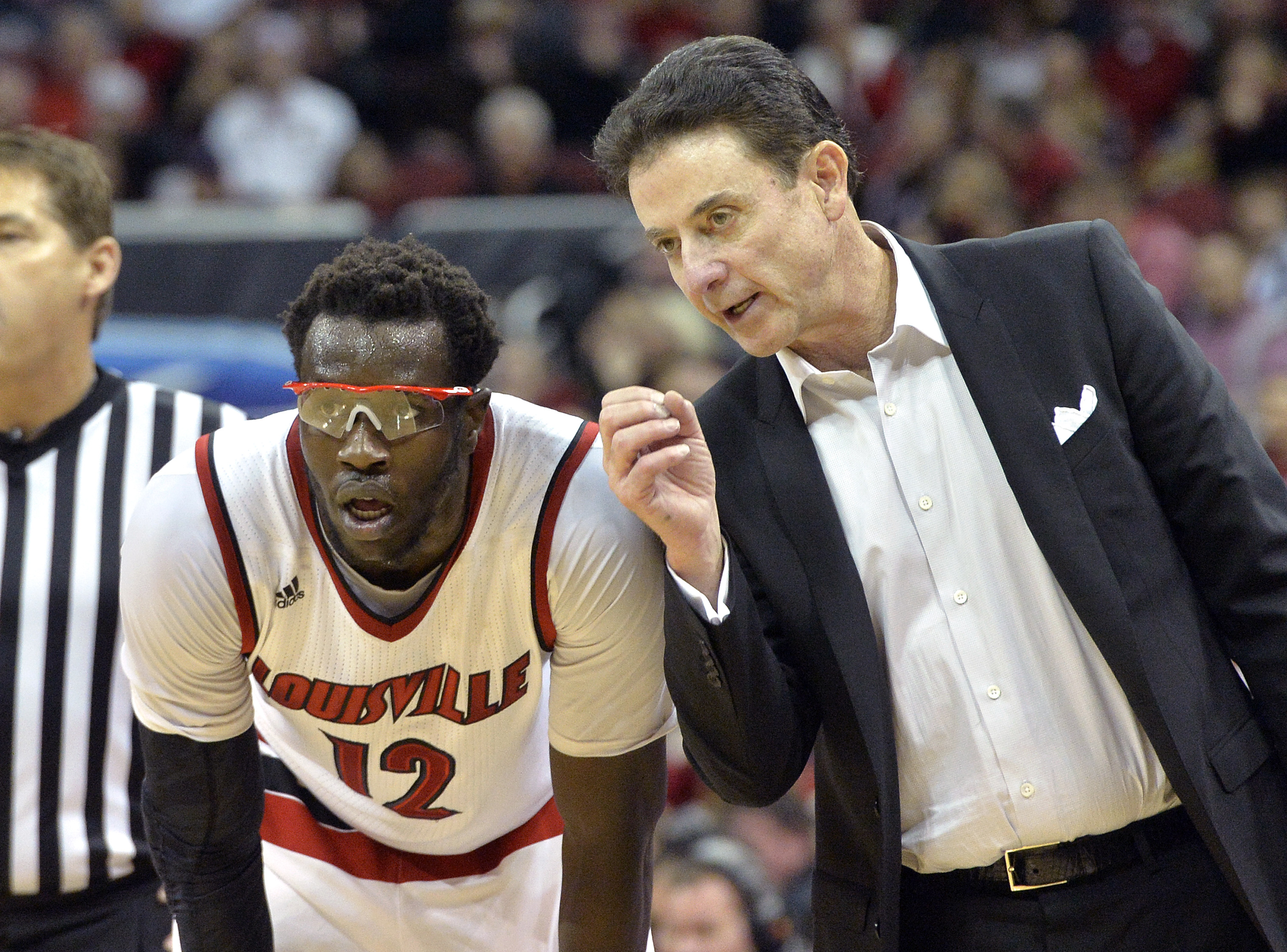 Louisville head coach Rick Pitino, right, talks to Mangok Mathiang during the second half of an NCAA college basketball game against Western Kentucky, Saturday, Dec. 19, 2015, in Louisville, Ky. Louisville won 78-56. (AP Photo/Timothy D. Easley)