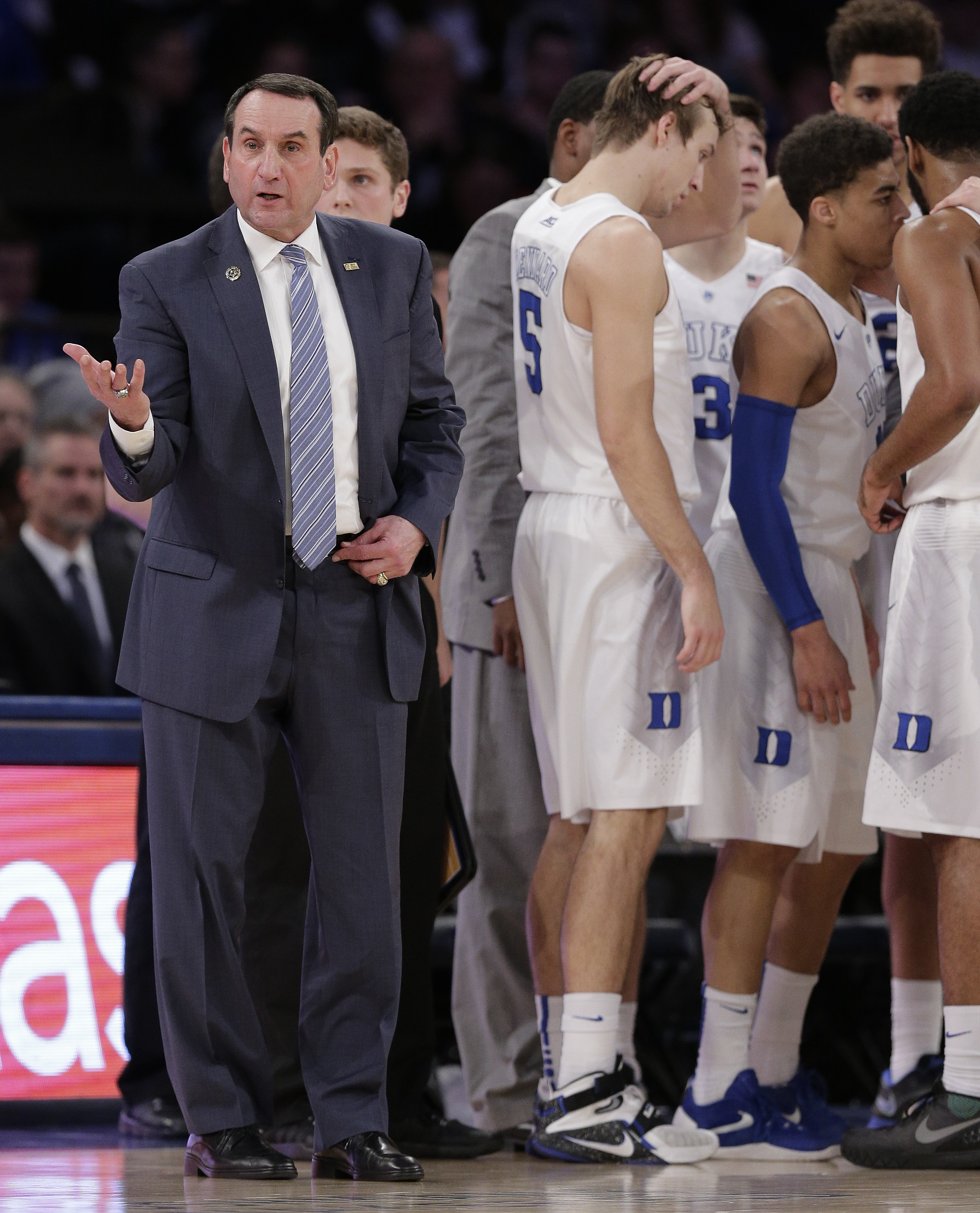 Duke head coach Mike Krzyzewski looks to the referee for a goal tending call as the team gathers during a timeout in the first half of an NCAA college basketball game against Utah, Saturday, Dec. 19, 2015, in New York. (AP Photo/Julie Jacobson)