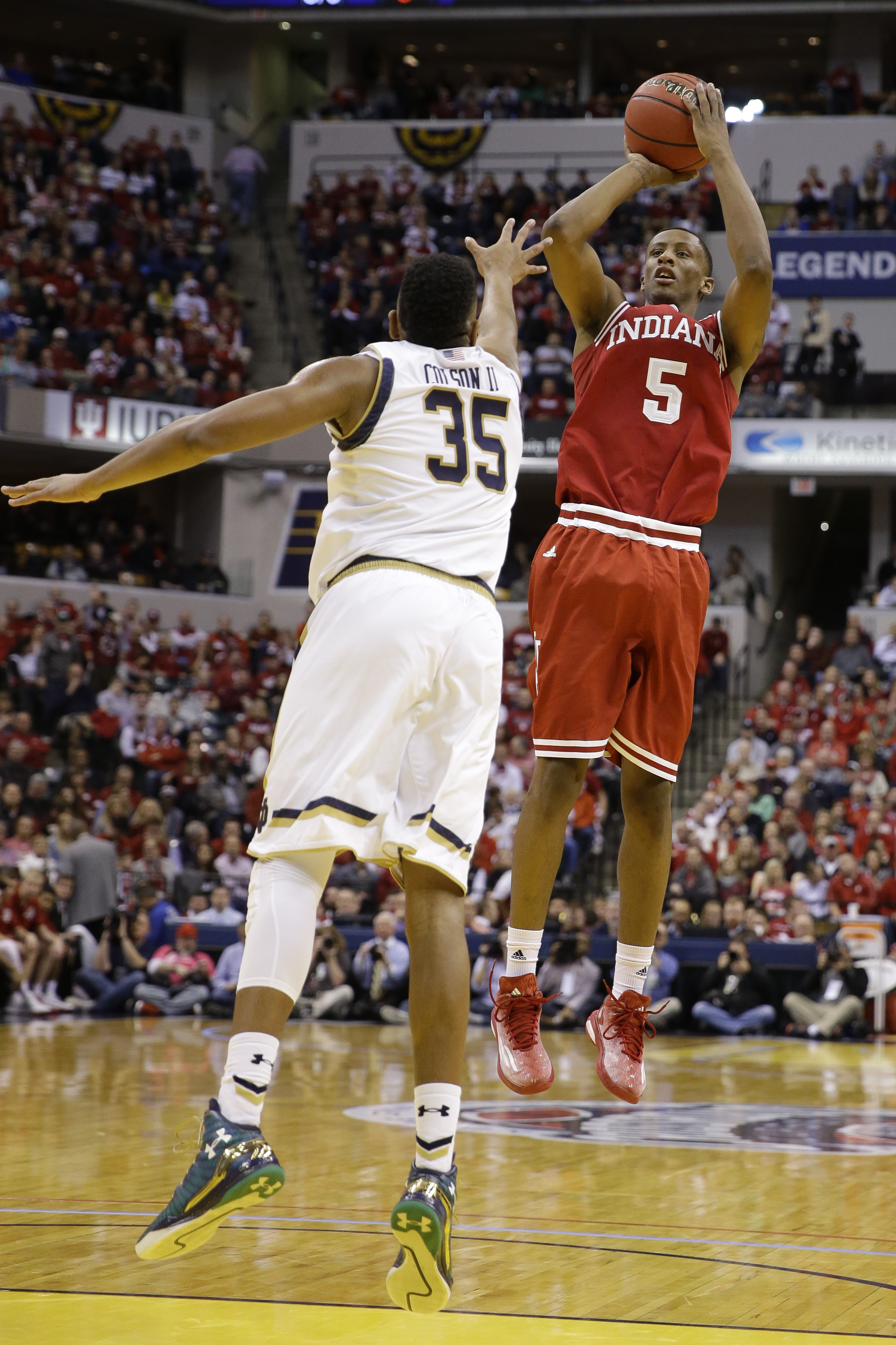 Indiana forward Troy Williams (5) shoots over Notre Dame forward Bonzie Colson (35) in the first half of an NCAA college basketball game in Indianapolis, Saturday, Dec. 19, 2015. Indiana defeated Notre Dame 80-73. (AP Photo/Michael Conroy)