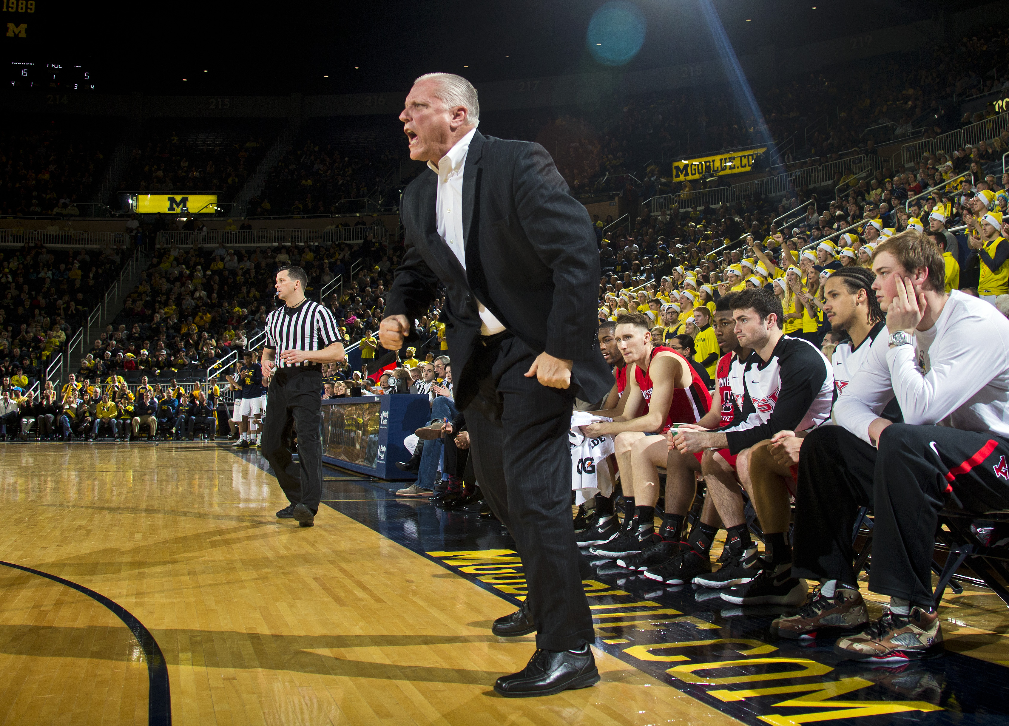 Youngstown State head coach Jerry Slocum reacts courtside in the first half of an NCAA college basketball game against Michigan in Ann Arbor, Mich., Saturday, Dec. 19, 2015. (AP Photo/Tony Ding)