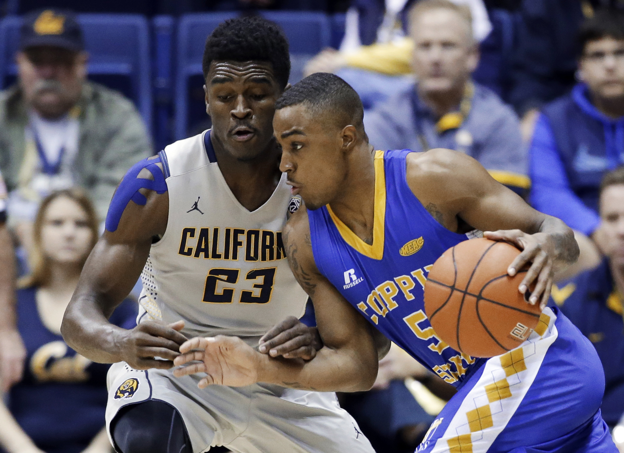 Coppin State guard James Sylvester (5) tries to dribble around California guard Jabari Bird (23) during the first half of an NCAA college basketball game Saturday, Dec. 19, 2015, in Berkeley, Calif. (AP Photo/Marcio Jose Sanchez)