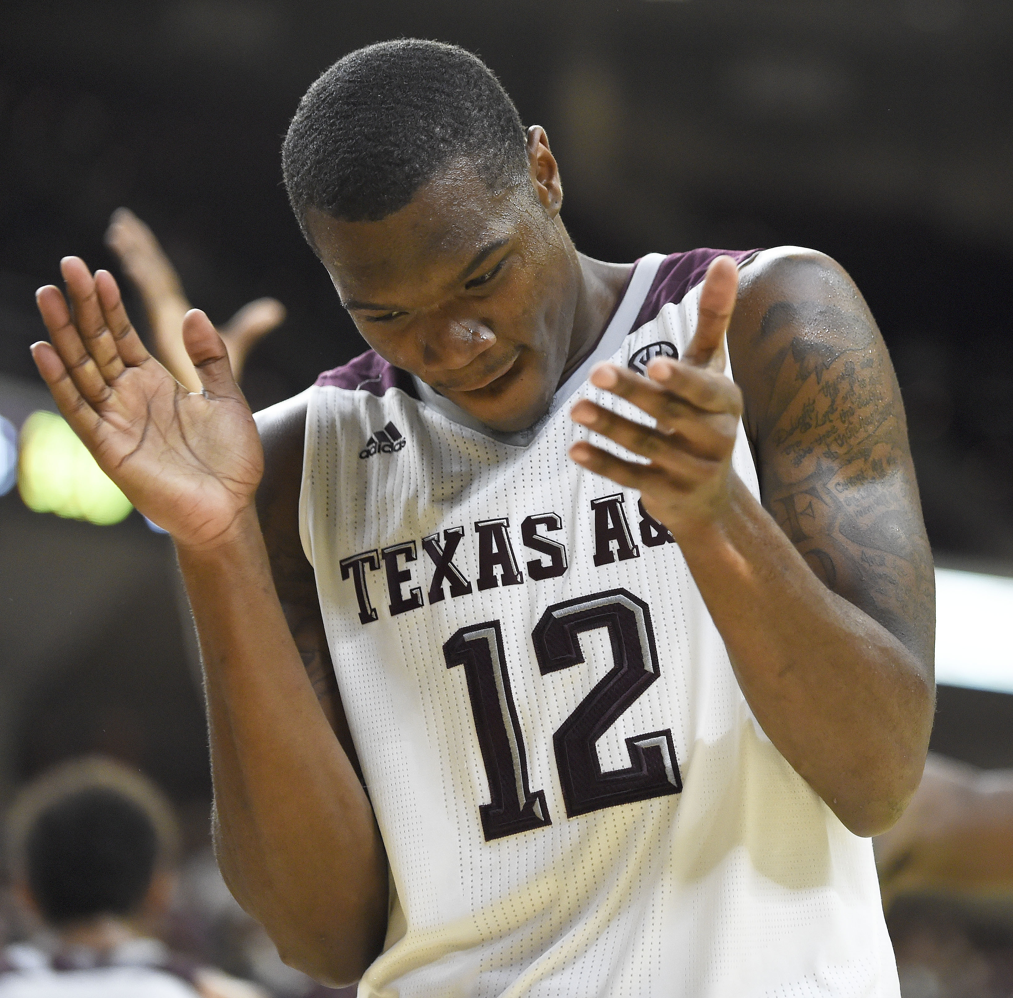 Texas A&M guard Jalen Jones (12) reacts after a Baylor turnover during the second half of an NCAA college basketball game Saturday, Dec. 19, 2015, in College Station, Texas. Texas A&M won 80-61. (AP Photo/Eric Christian Smith)