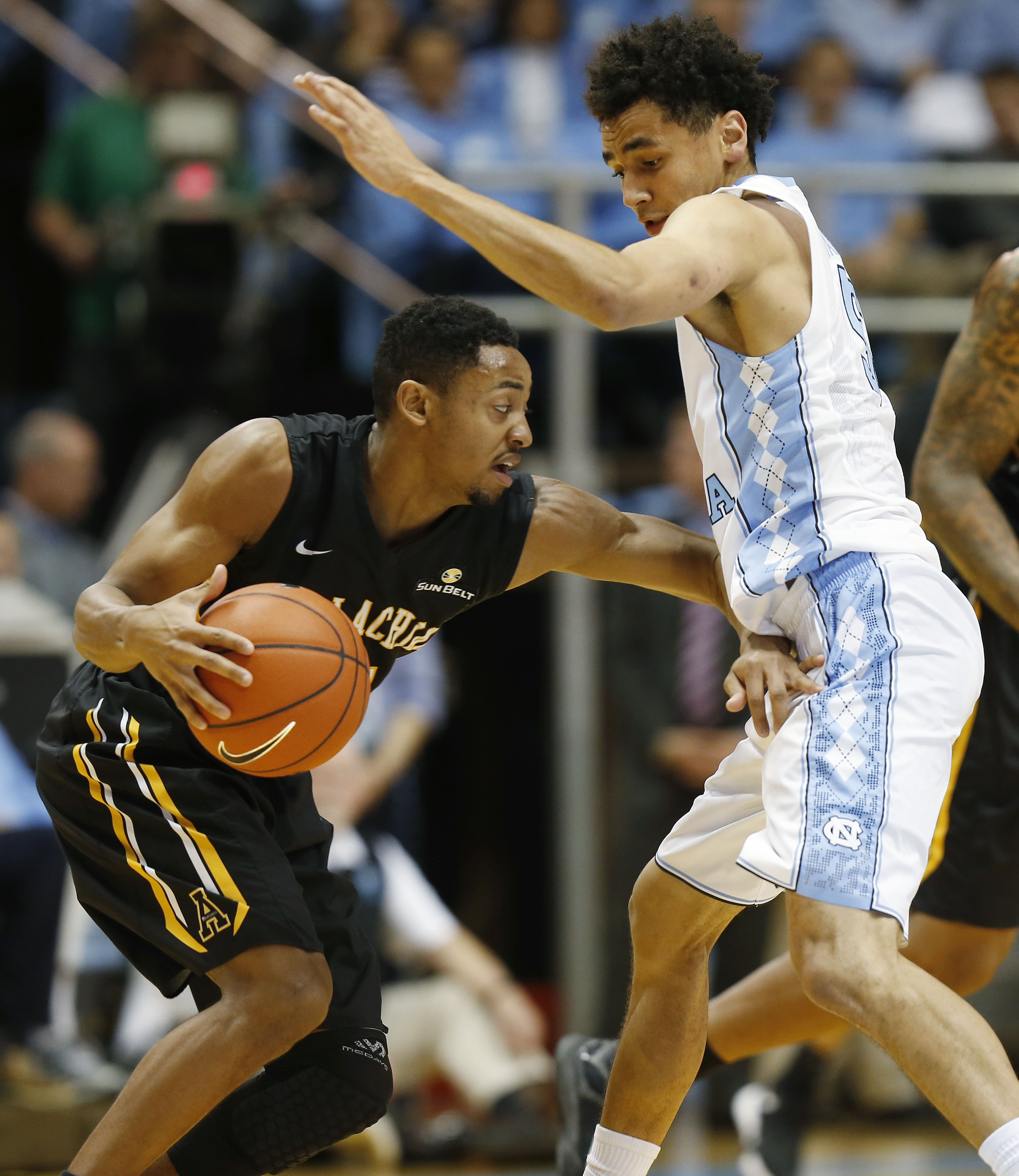 North Carolina's Marcus Paige, right, defends Appalachian State's Frank Eaves during the first half of an NCAA college basketball game Monday, Dec. 21, 2015, in Chapel Hill, N.C. (AP Photo/Ellen Ozier)