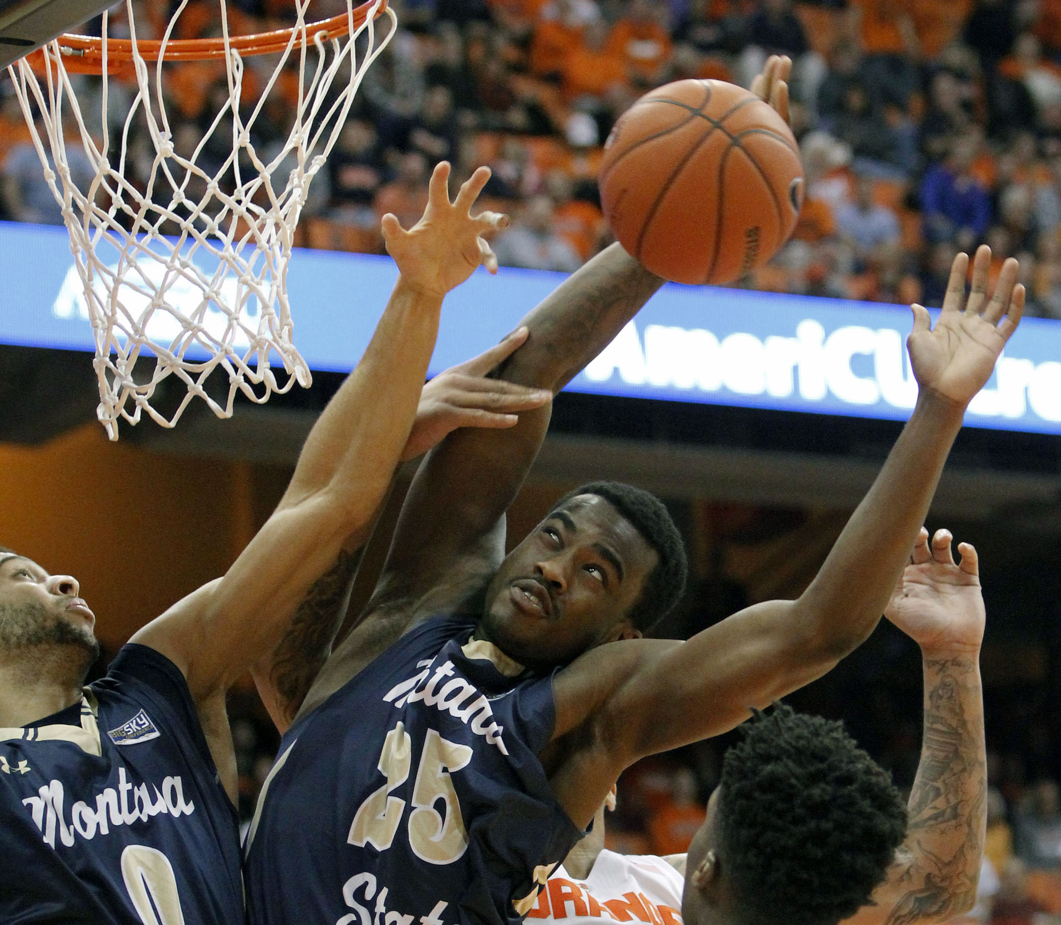 Montana State's Shy Blake, right, grabs a rebound dominating the boards with teammate Zach Green, left, in the first half of an NCAA college basketball game in Syracuse, N.Y., Tuesday, Dec. 22, 2015. (AP Photo/Nick Lisi)