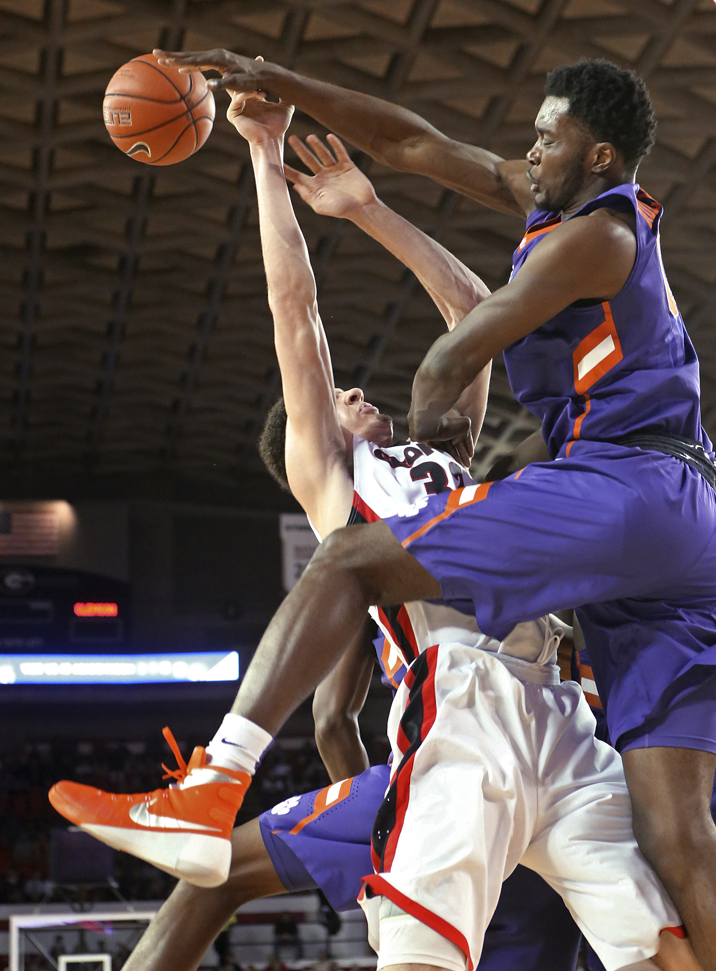 Clemson center Legend Robertin blocks a shot by Georgia forward Mike Edwards during an NCAA college basketball game Tuesday, Dec. 22, 2015, in Athens, Ga. Georgia defeated Clemson 71-48. (Curtis Compton/Atlanta Journal Constitution via AP)