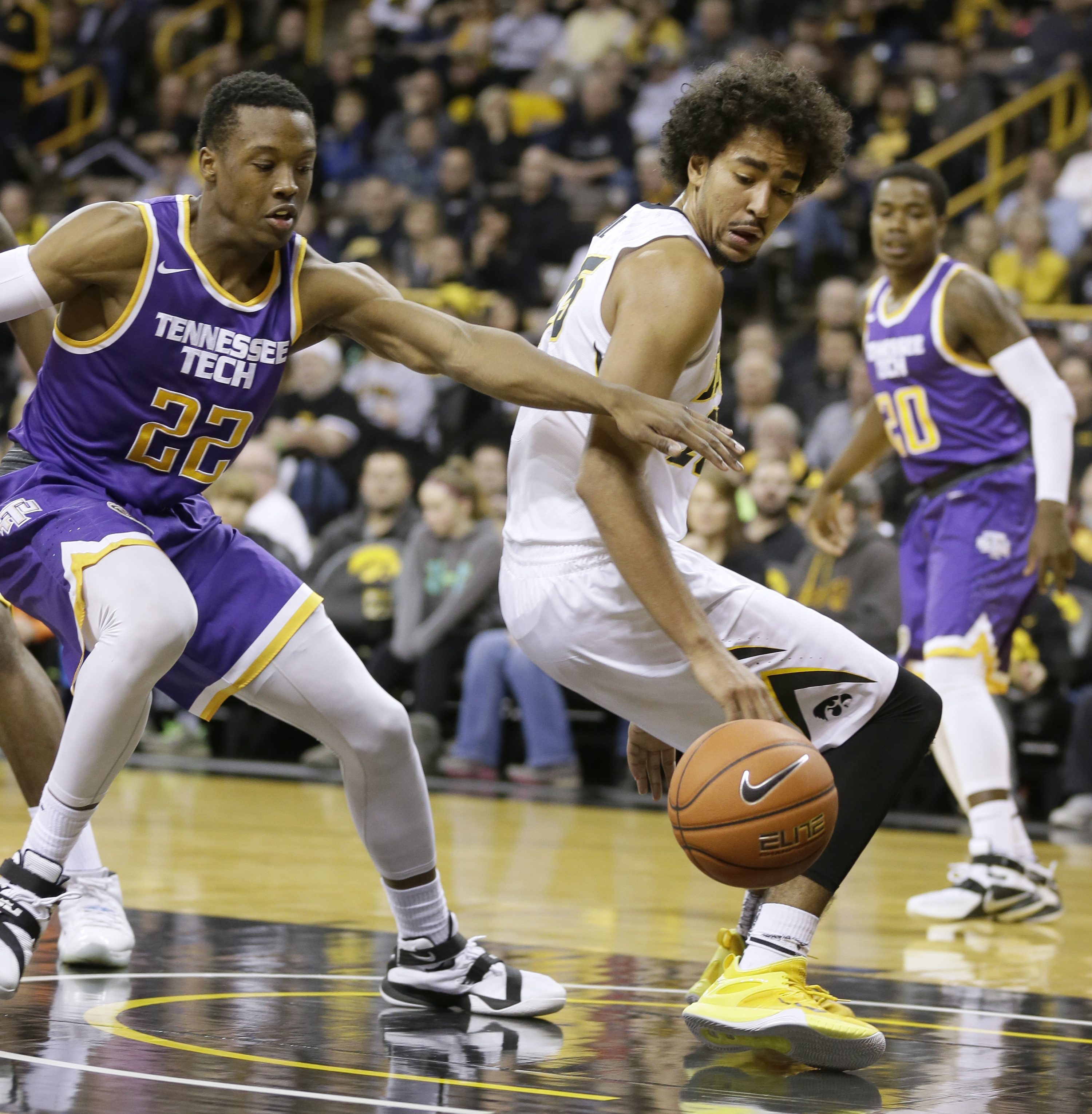 Tennessee Tech forward Courtney Alexander II, left, fights for the ball with Iowa forward Dom Uhl during the first half of an NCAA college basketball game, Tuesday, Dec. 22, 2015, in Iowa City, Iowa. (AP Photo/Charlie Neibergall)