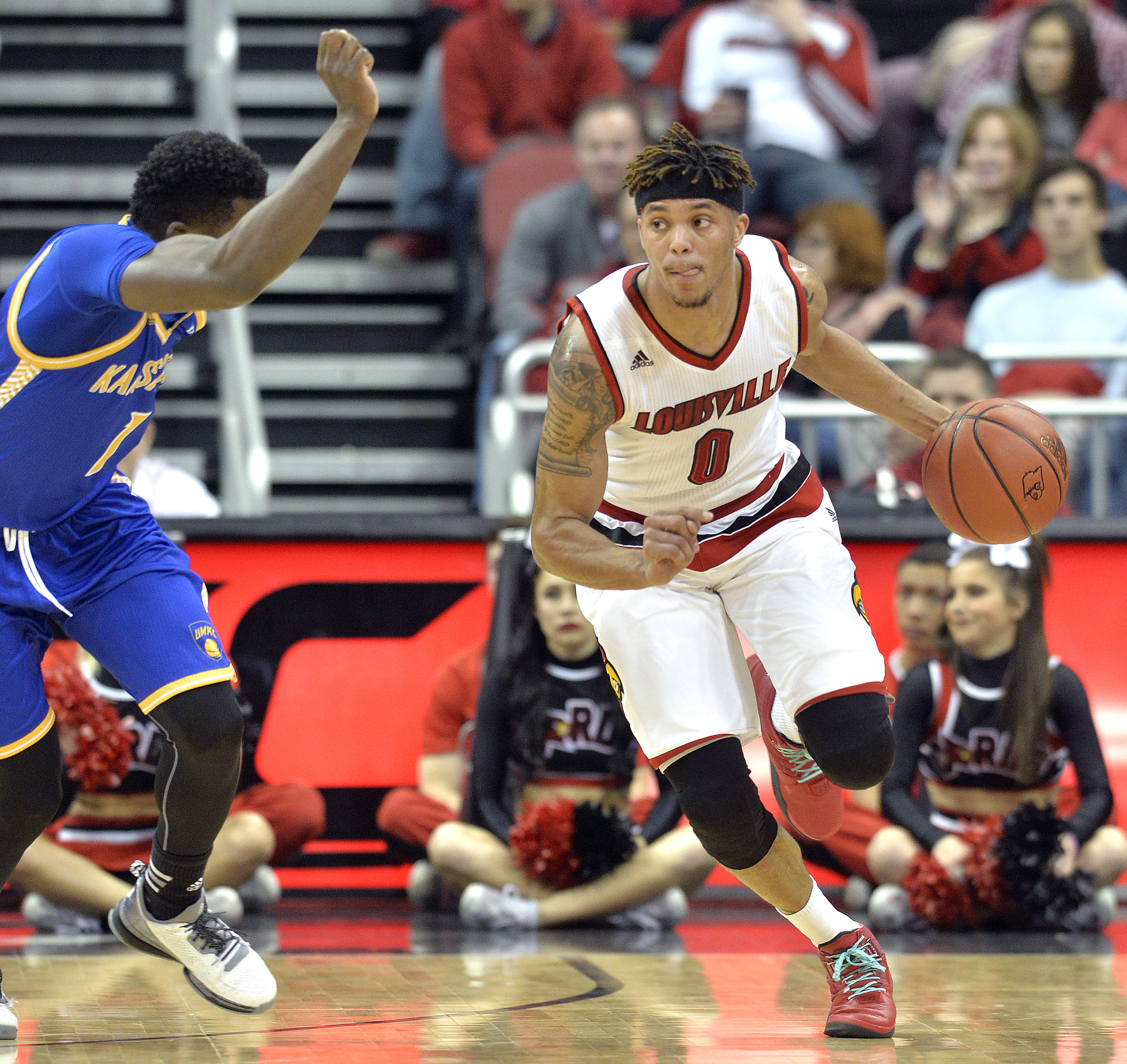 Louisville's Damion Lee (0) drives against UMKC's Dashawn King (1) during the first half of an NCAA college basketball game, Tuesday, Dec. 22, 2015, in Louisville, Ky. (AP Photo/Timothy D. Easley)