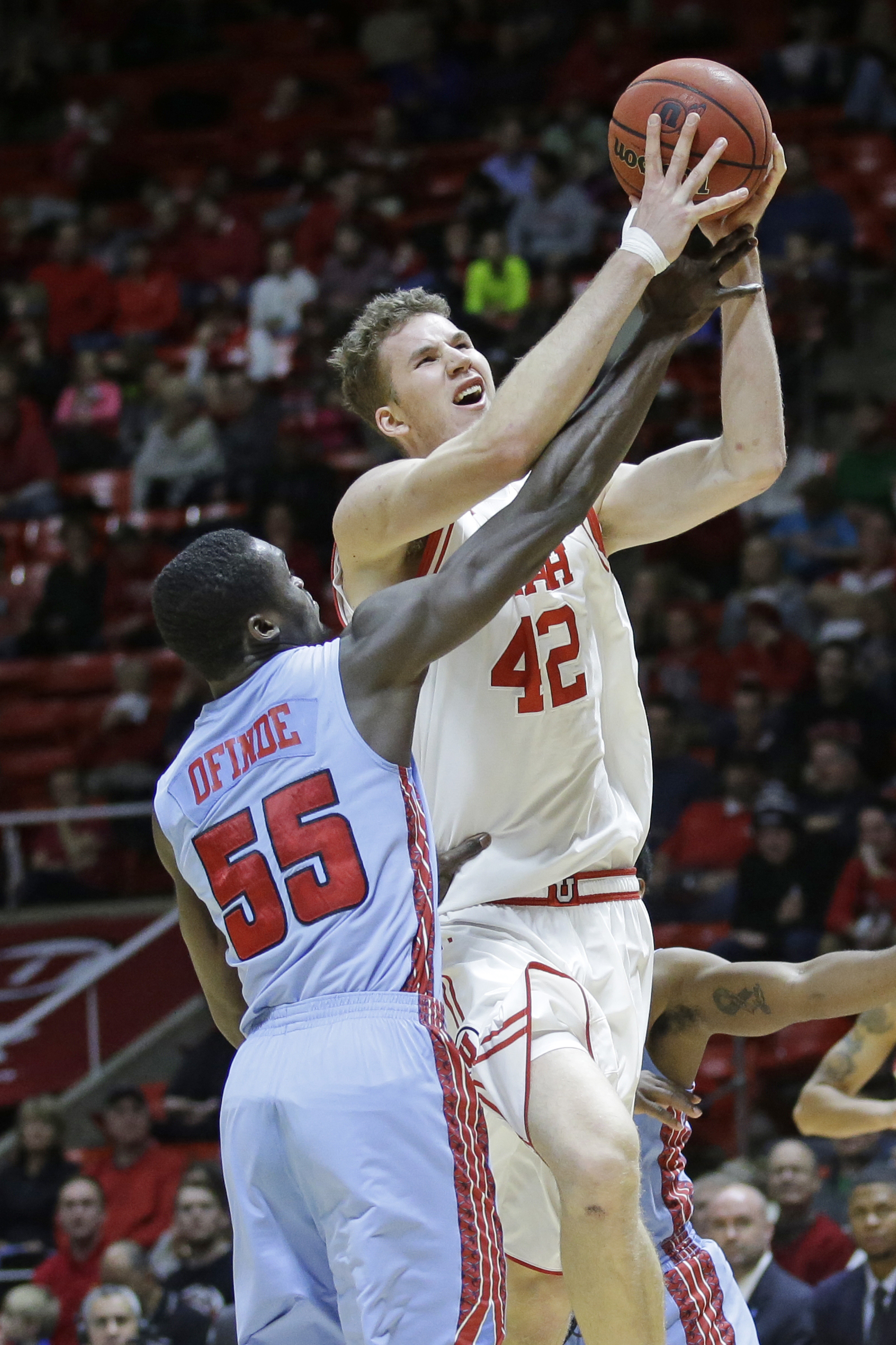 Utah forward Jakob Poeltl (42) goes to the basket as Delaware State center Demola Onifade (55) defends during the second half of an NCAA college basketball game Tuesday, Dec. 22, 2015, in Salt Lake City.  (AP Photo/Rick Bowmer)
