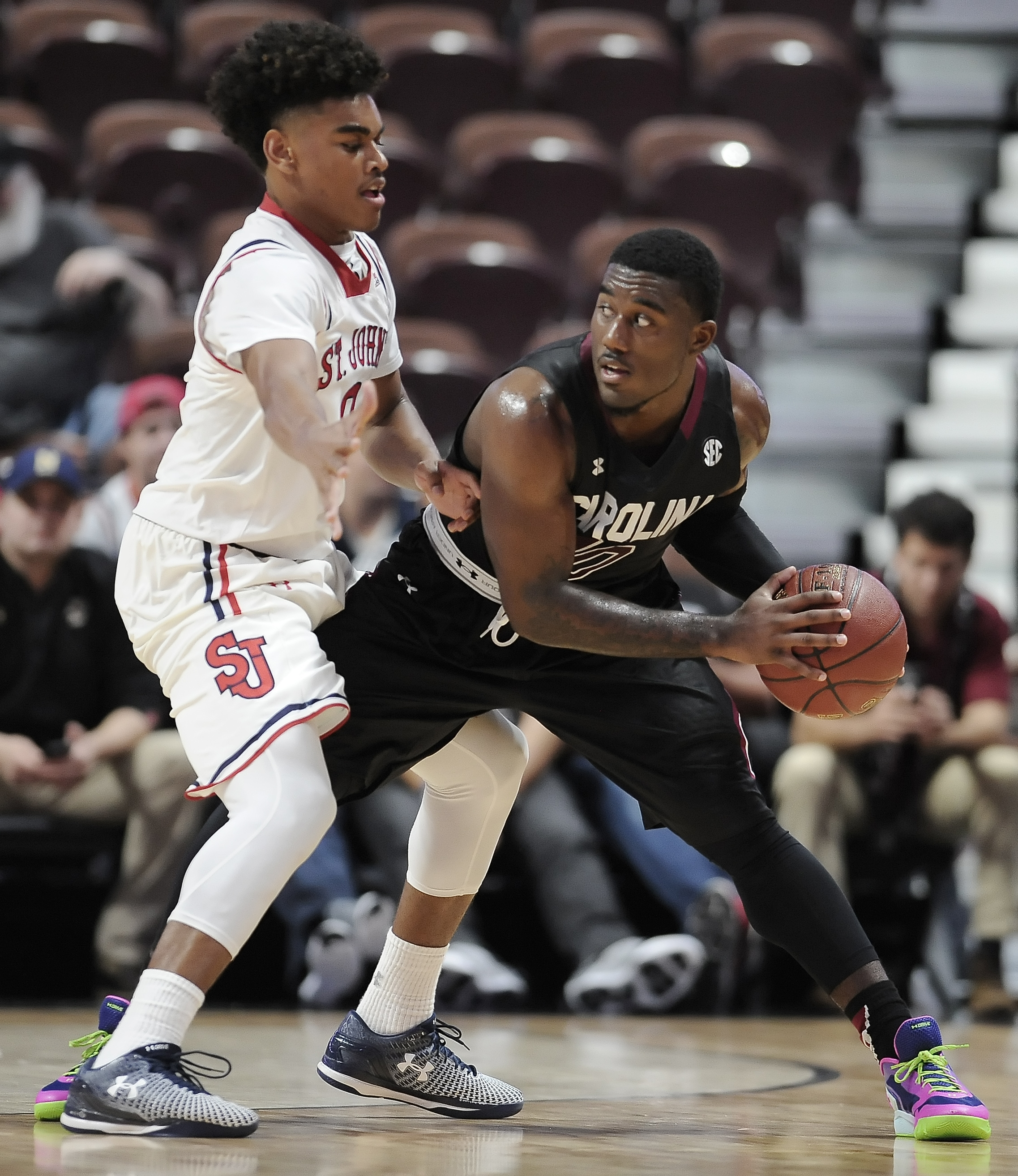 St. John's Malik Ellison, left, guards South Carolina's Duane Notice, during the second half of an NCAA college basketball game Tuesday, Dec. 22, 2015, in Uncasville, Conn. South Carolina won 75-61. (AP Photo/Jessica Hill)