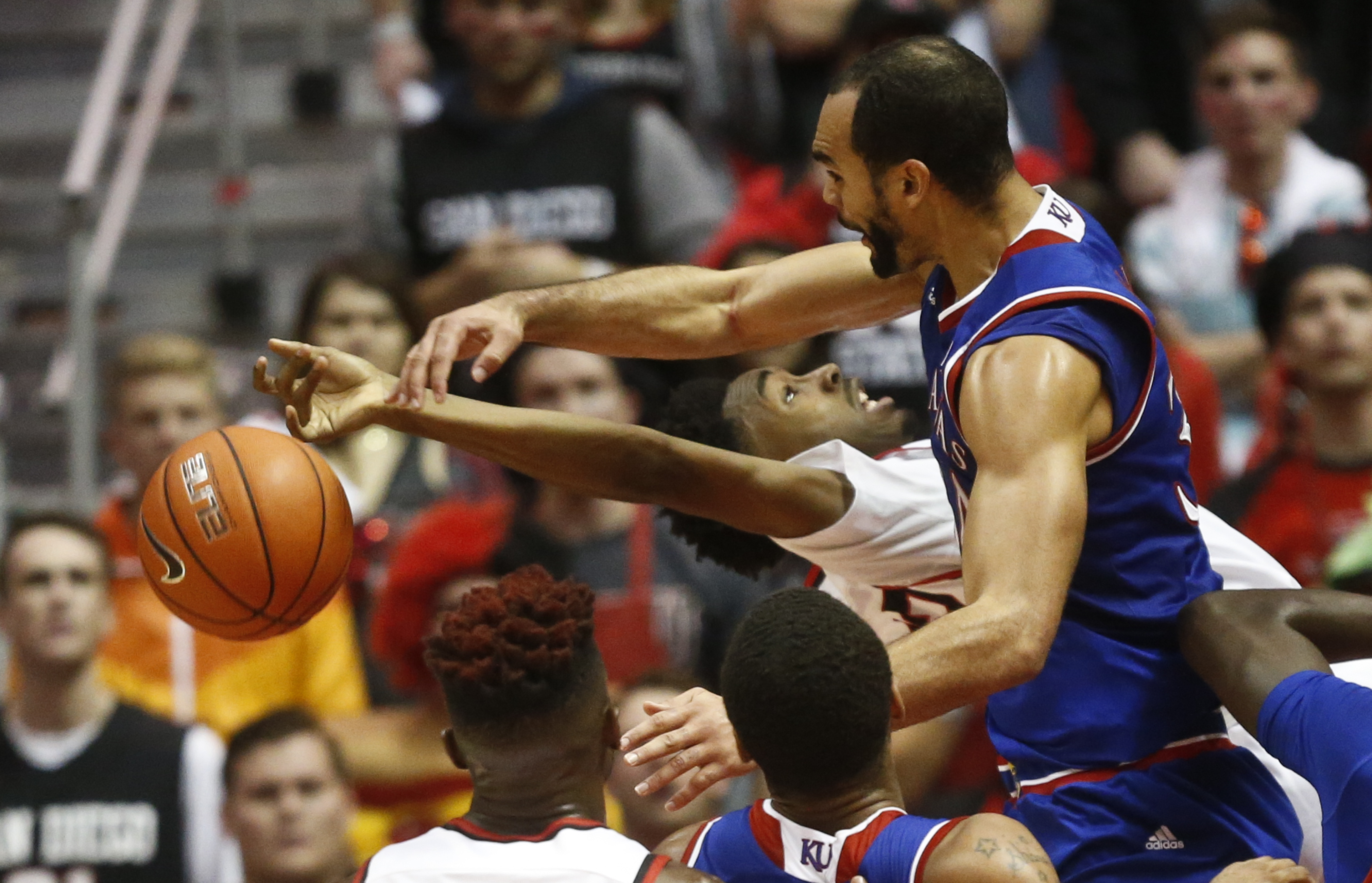 Kansas forward Perry Ellis blocks the shot of San Diego State guard Jeremy Hemsley during the first half of an NCAA college basketball game Tuesday, Dec. 22, 2015, in San Diego. (AP Photo/Lenny Ignelzi)