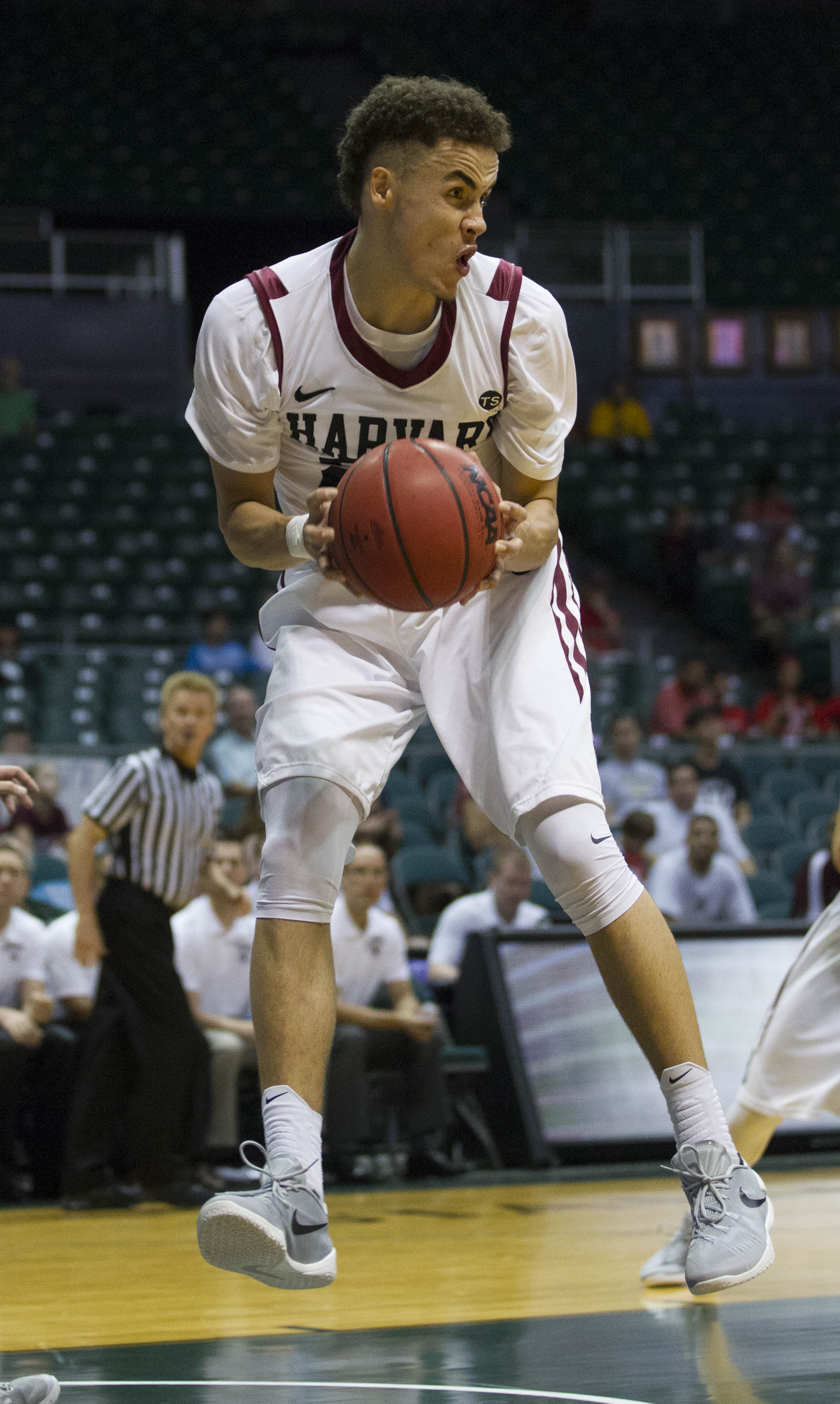 Harvard guard Corey Johnson (25) controls a rebound while playing against Auburn in the first half of an NCAA college basketball game at the Diamond Head Classic, Wednesday, Dec. 23, 2015, in Honolulu. Harvard won 69-51. (AP Photo/Eugene Tanner)