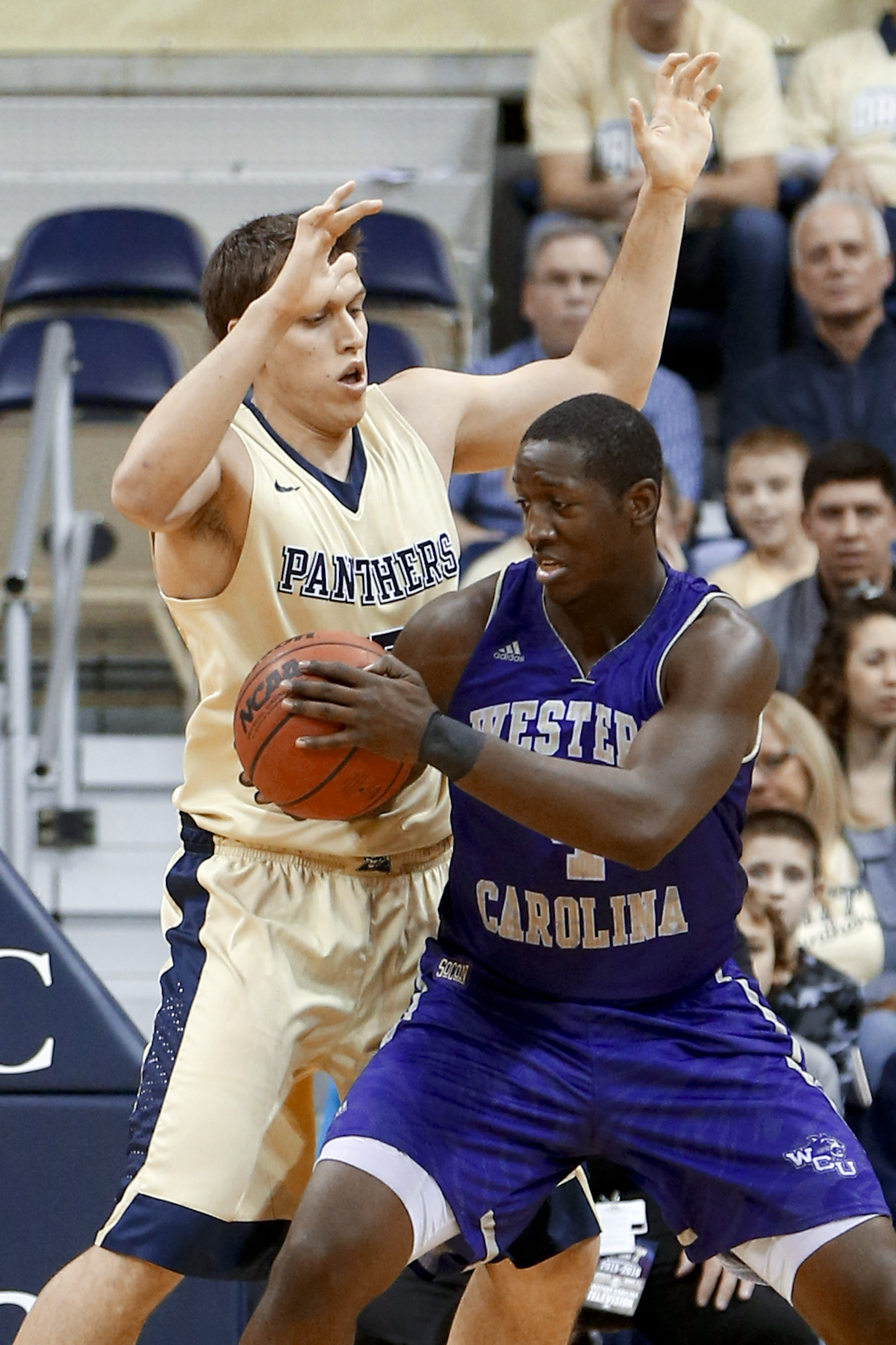 Pittsburgh's Rafael Maia, left, defends as Western Carolina's Torrion Brummitt, right, looks to shoot in the first half of an NCAA college basketball game, Wednesday, Dec. 23, 2015, in Pittsburgh. (AP Photo/Keith Srakocic)