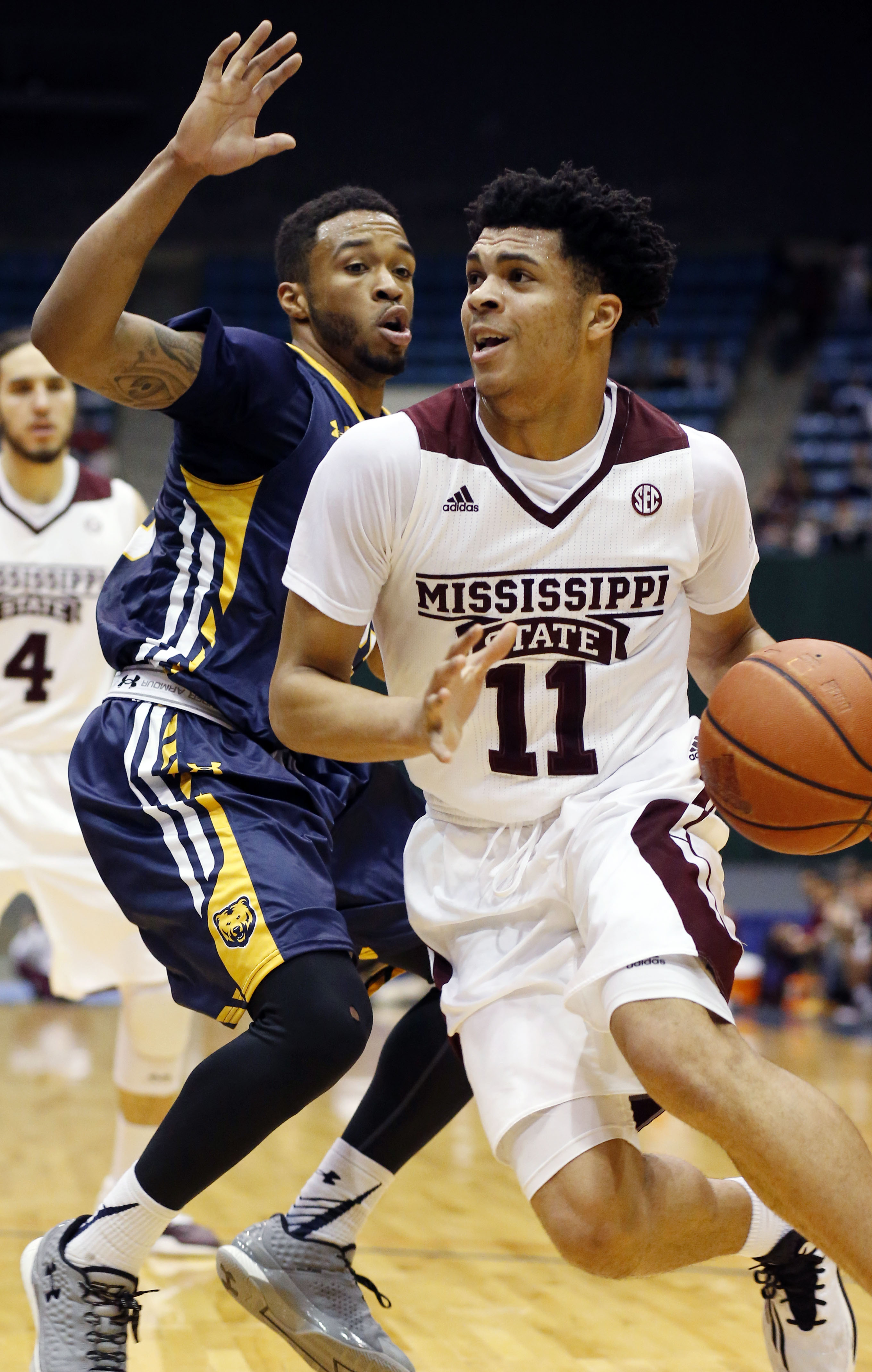 Mississippi State guard Quinndary Weatherspoon (11) dribbles past Northern Colorado guard Dallas Anglin during the first half of an NCAA college basketball game in Jackson, Miss., Wednesday, Dec. 23, 2015. (AP Photo/Rogelio V. Solis)